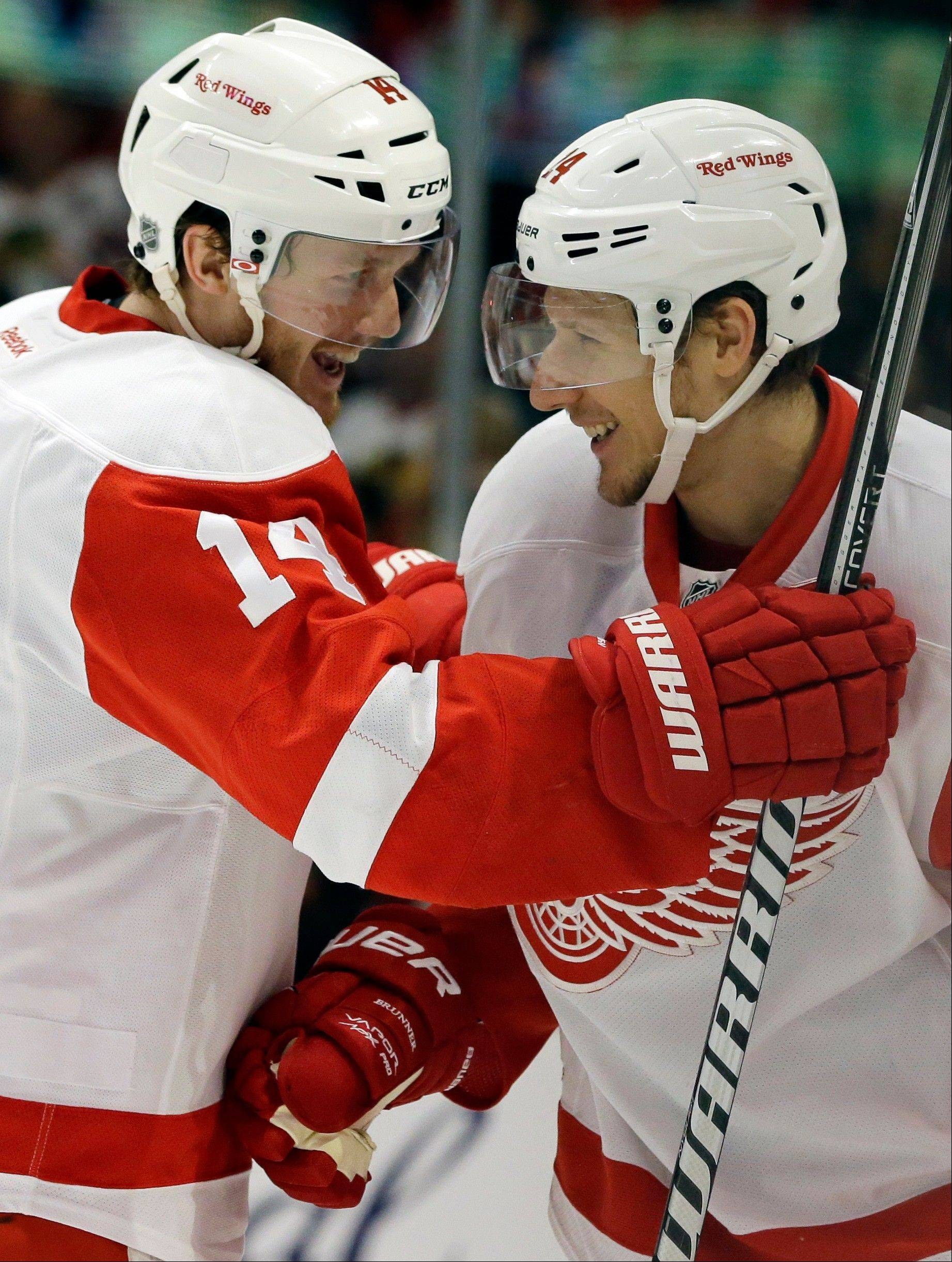 Detroit Red Wings' Damien Brunner (24), right, celebrates with teammate Gustav Nyquist (14) after scoring a goal against the Chicago Blackhawks during the first period of Game 1 of an NHL hockey playoffs Western Conference semifinal in Chicago, Wednesday, May 15, 2013.