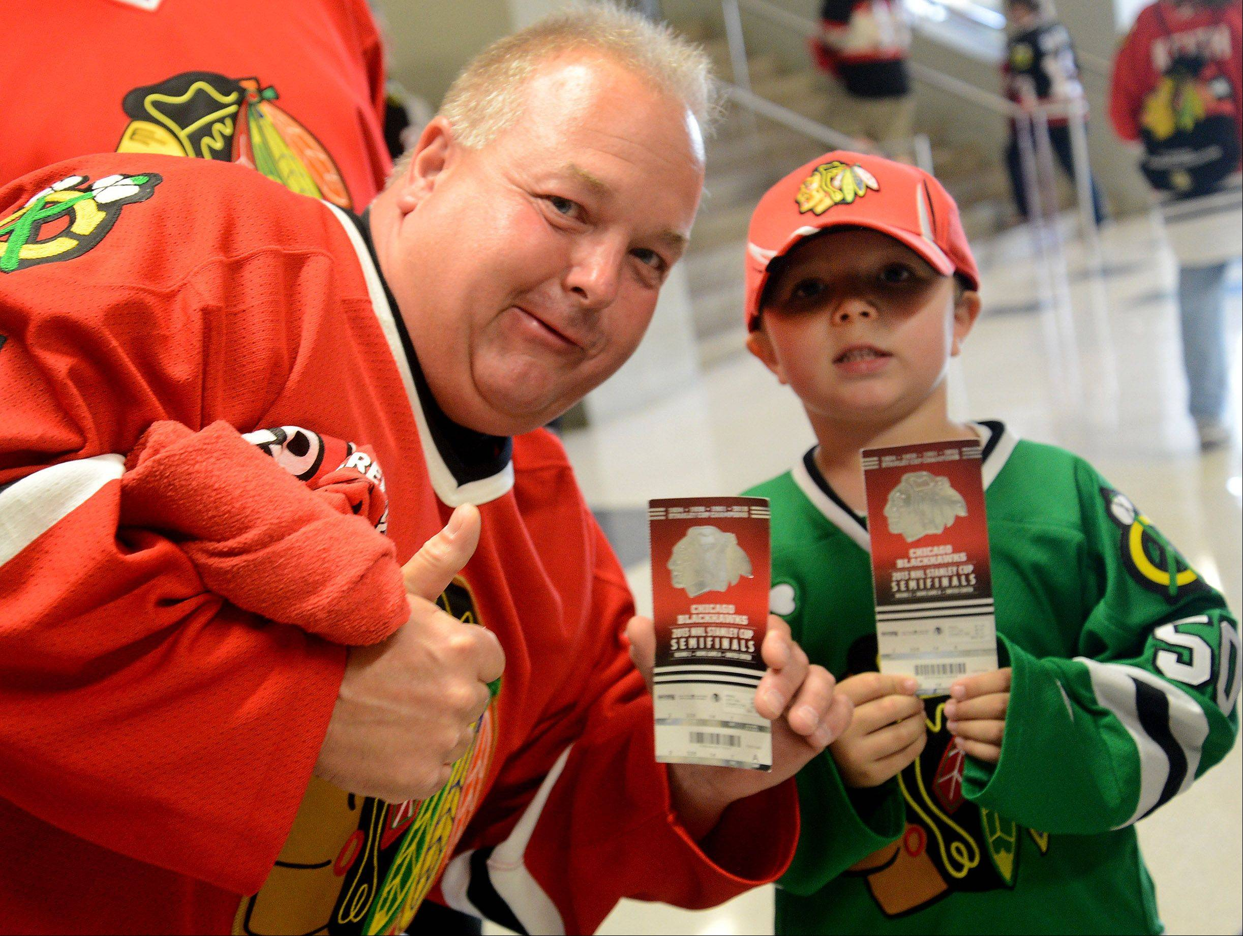 Mike and his son Mikey Szorc of Chicago got their tickets for Game 1 of Western Conference semifinals between the Chicago Blackhawks and the Detroit Red Wings.