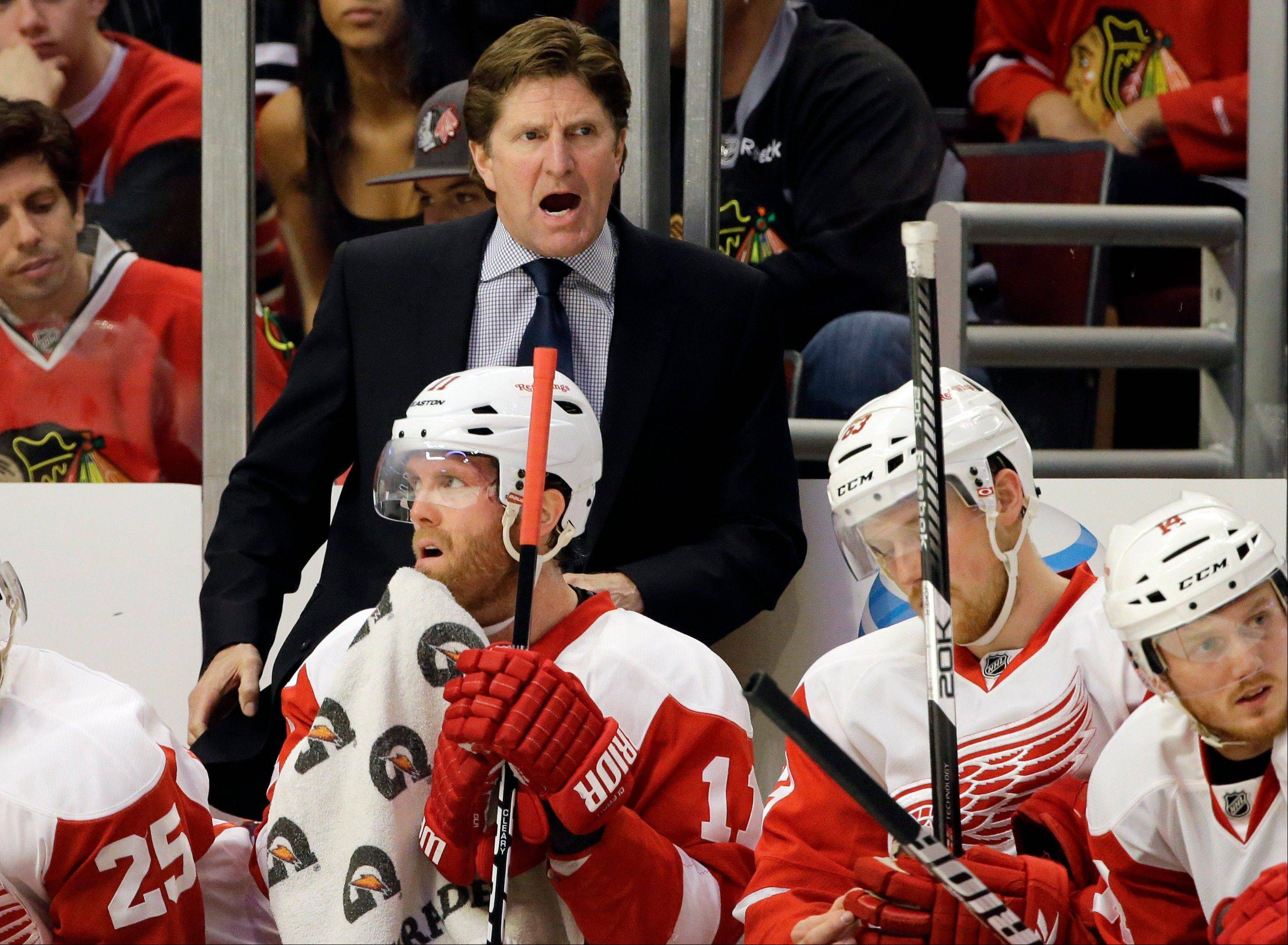 Detroit Red Wings head coach Mike Babcock, top, yells his team during the first period of Game 1 of an NHL hockey playoffs Western Conference semifinal against the Chicago Blackhawks in Chicago, Wednesday, May 15, 2013.