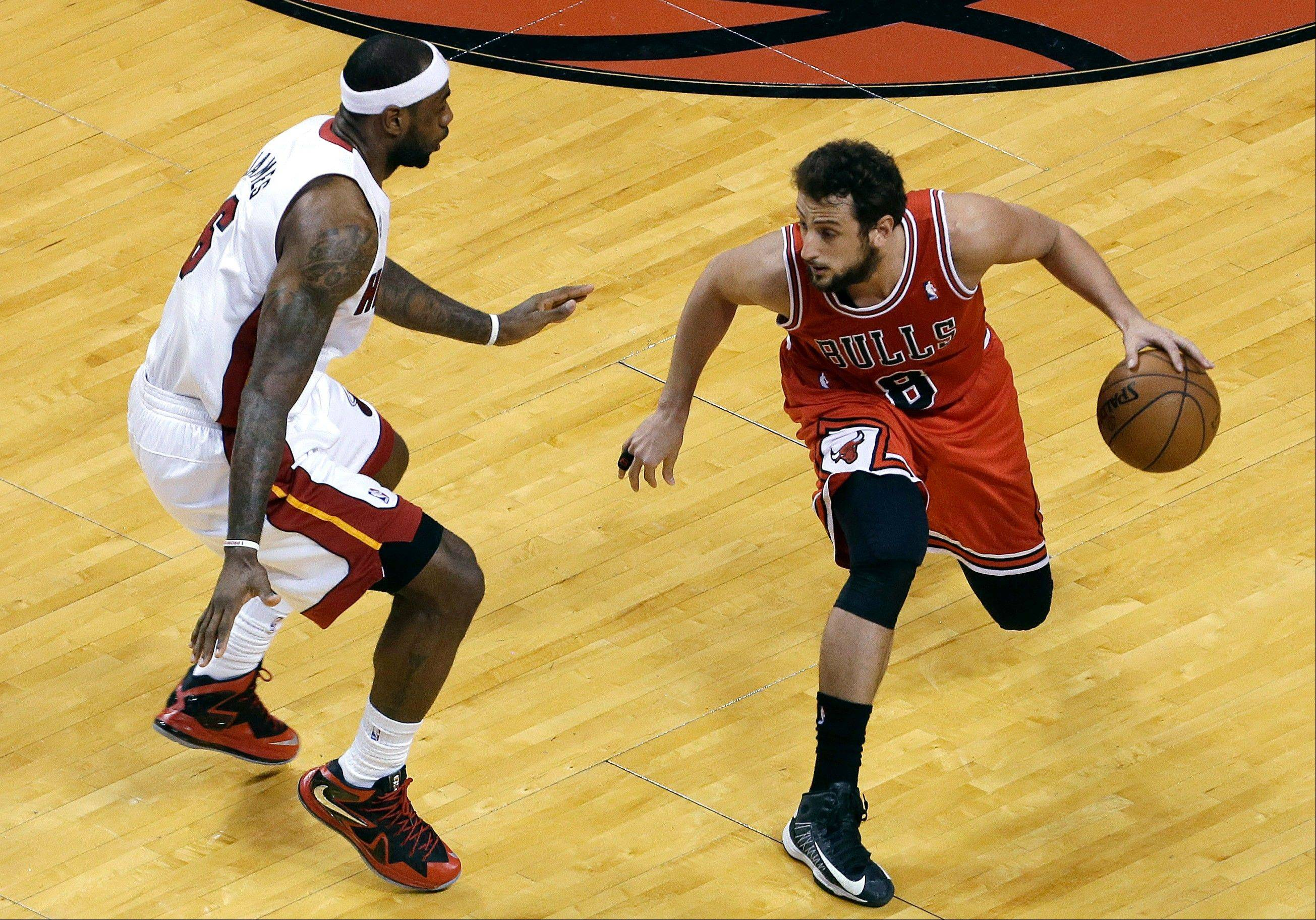 Chicago Bulls' Marco Belinelli (8) looks to move past Miami Heat's LeBron James (6) during the first half of Game 5 of an NBA basketball Eastern Conference semifinal series, Wednesday, May 15, 2013, in Miami.