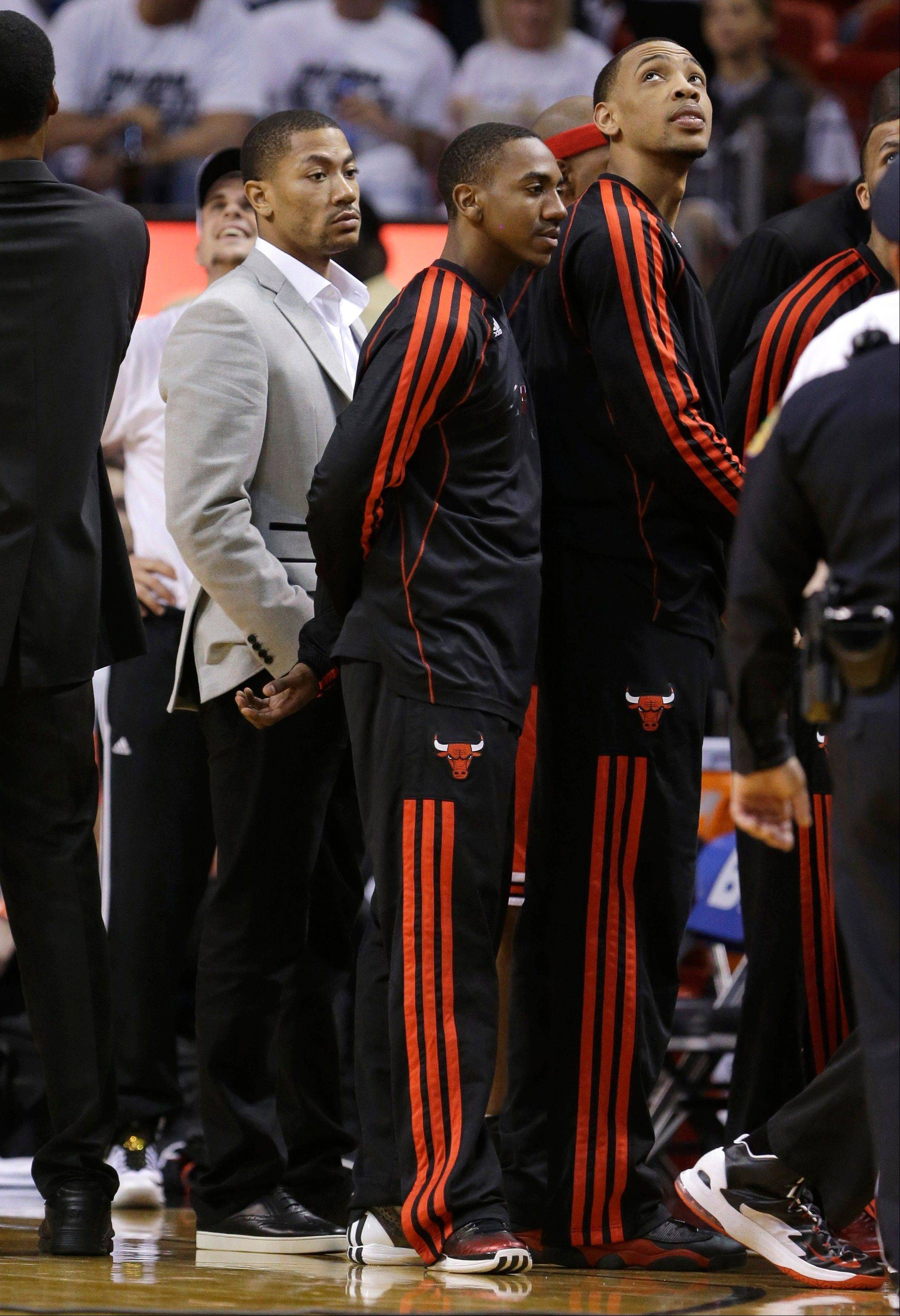 Chicago Bulls' Derrick Rose, left, stands with teammates during the second half of Game 5 of an NBA basketball Eastern Conference semifinal against the Miami Heat on Wednesday, May 15, 2013, in Miami.