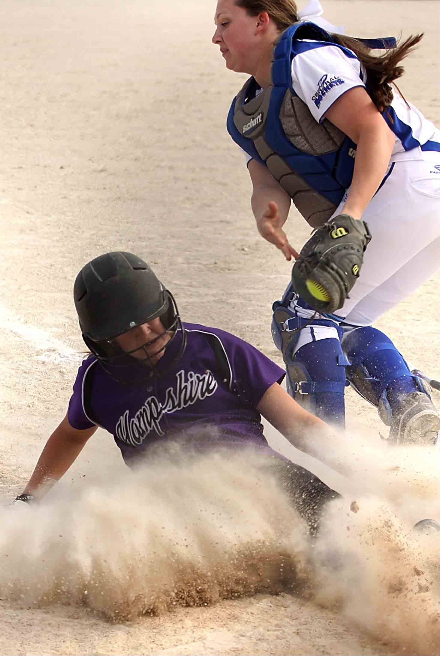Burlington Central catcher Bekah Harnish fields the throw as Hampshire's Alyssa Snider slides safely into home Wednesday at Burlington.