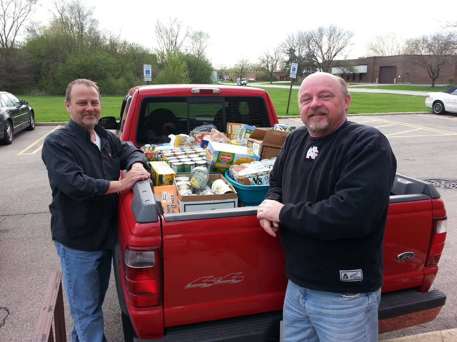 Dave Pearson (right) and Dean Scott (left) with the bed of the pick-up truck full of donated goods
