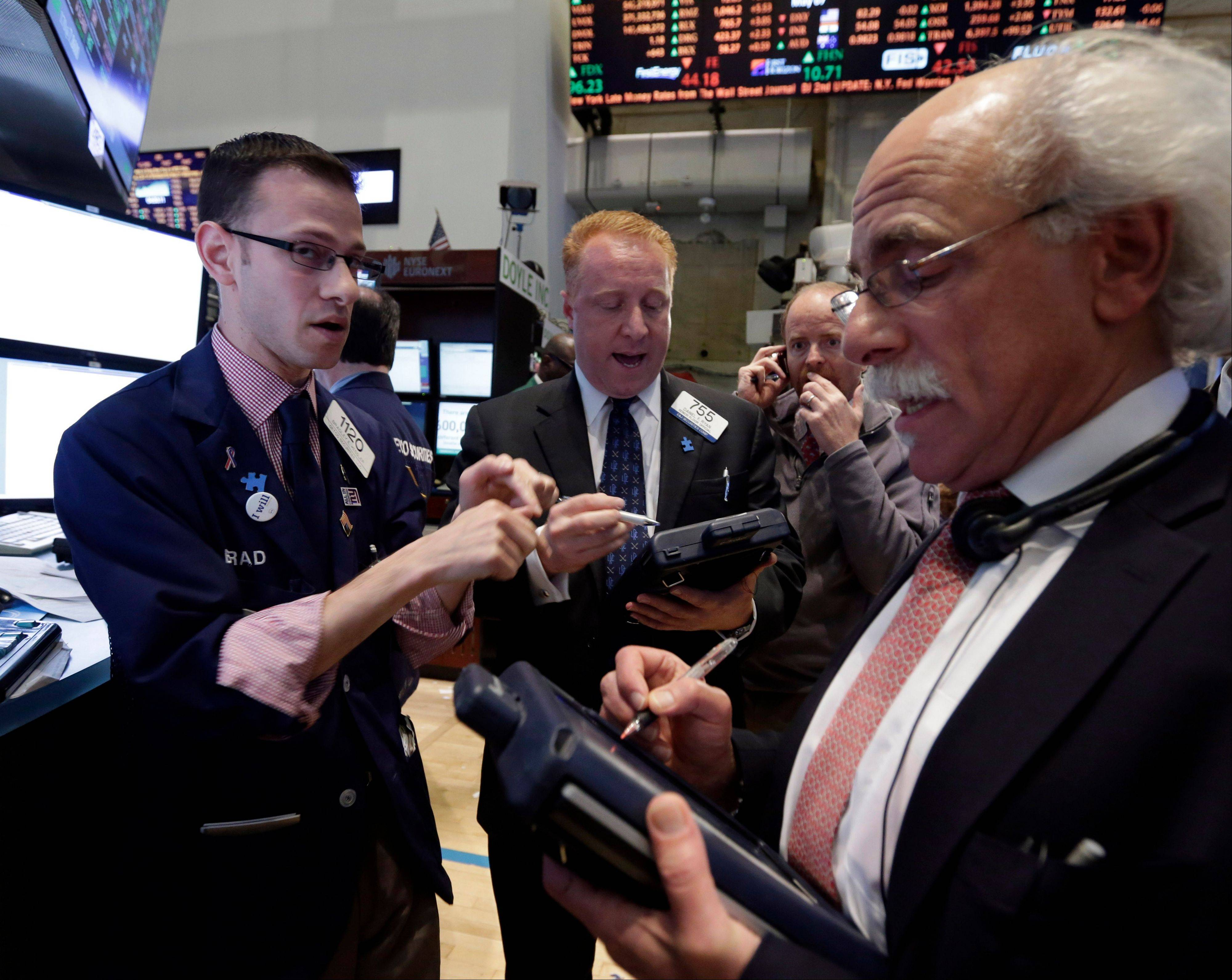 U.S. stocks fell, ending four days of records for the Standard & Poor�s 500 Index, amid disappointing economic data and after a Federal Reserve official said the central bank may slow the pace of stimulus as early as this summer.