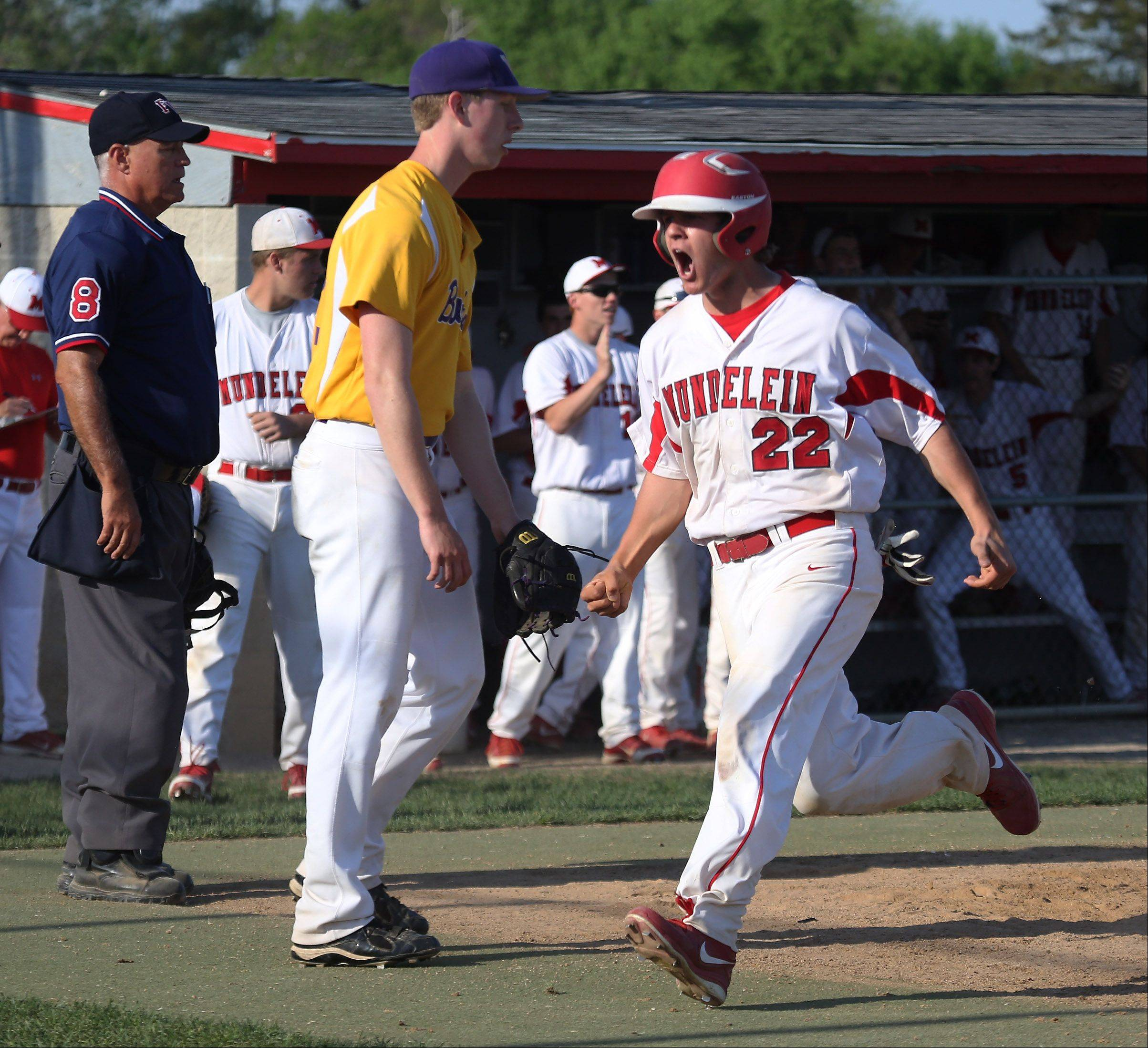 Mundelein runner Will Farmer cheers as he crosses home base in the fifth inning during the North Suburban Conference championship game against visiting Wauconda on Thursday.