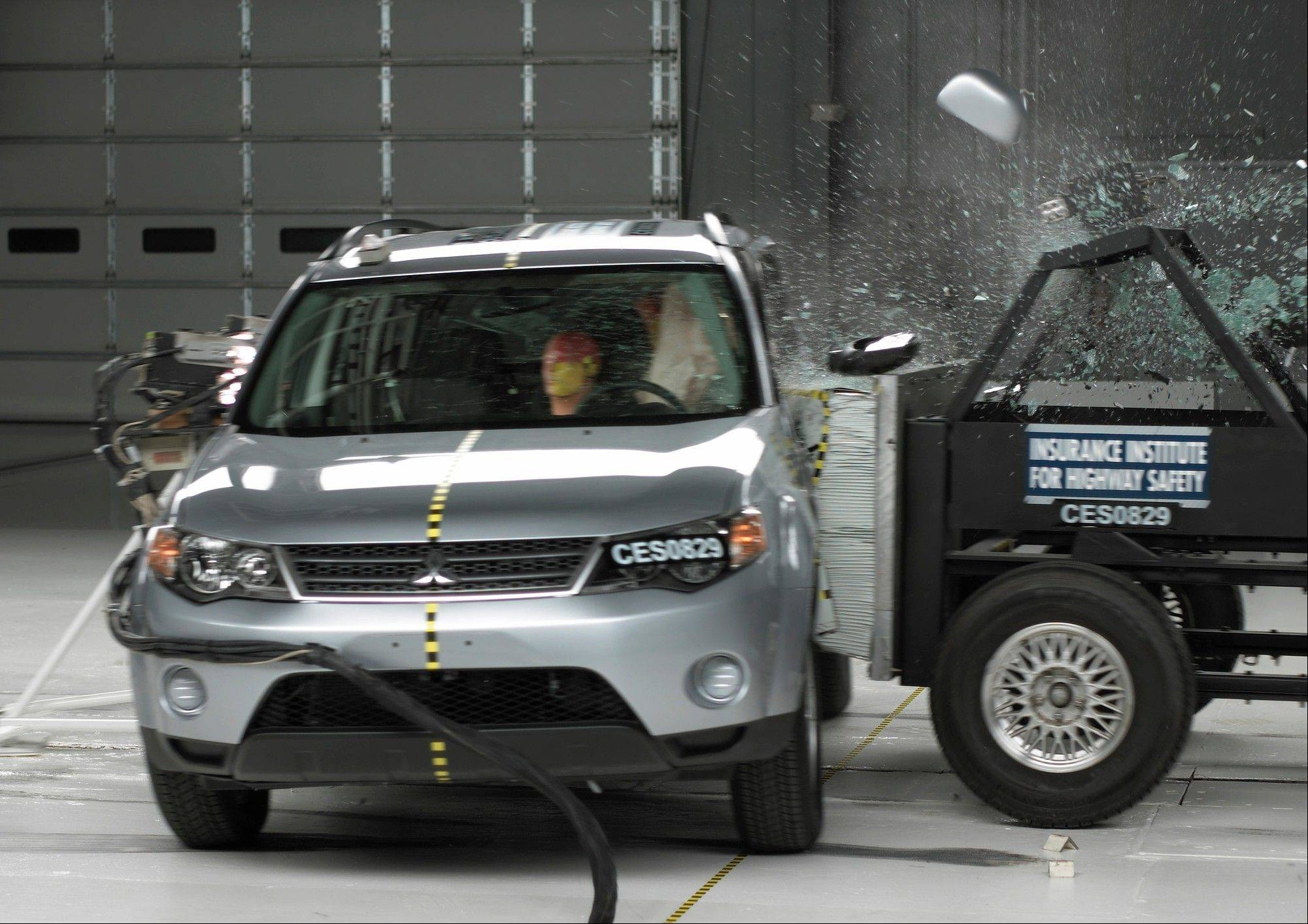 This undated handout photo provided by the Insurance Institute for Highway Safety shows a side crash of a 2008 Mitsubishi Outlander. A report released Thursday shows only two of 13 small SUVs are getting passing grades in front-end crash tests done by an insurance industry group.