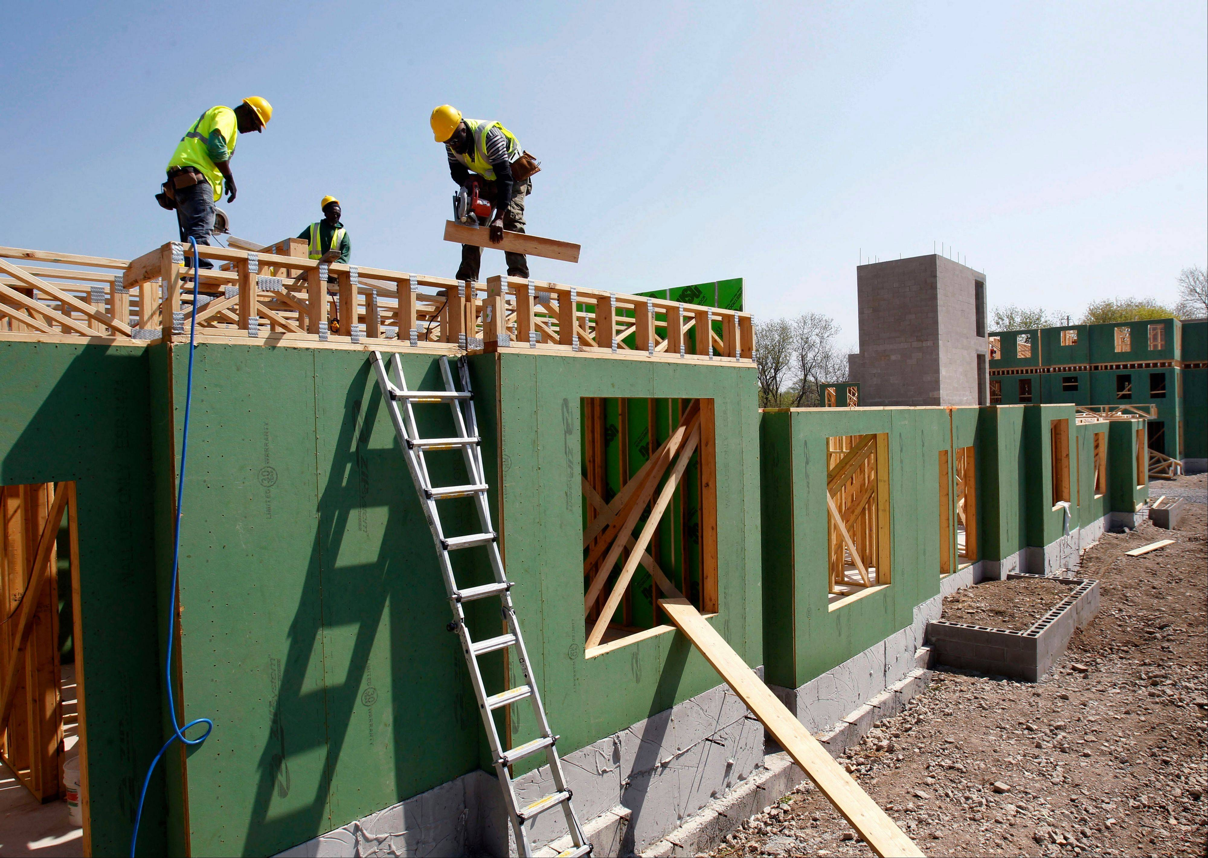 Workers at the construction of a new apartment housing complex in Trenton, N.J.