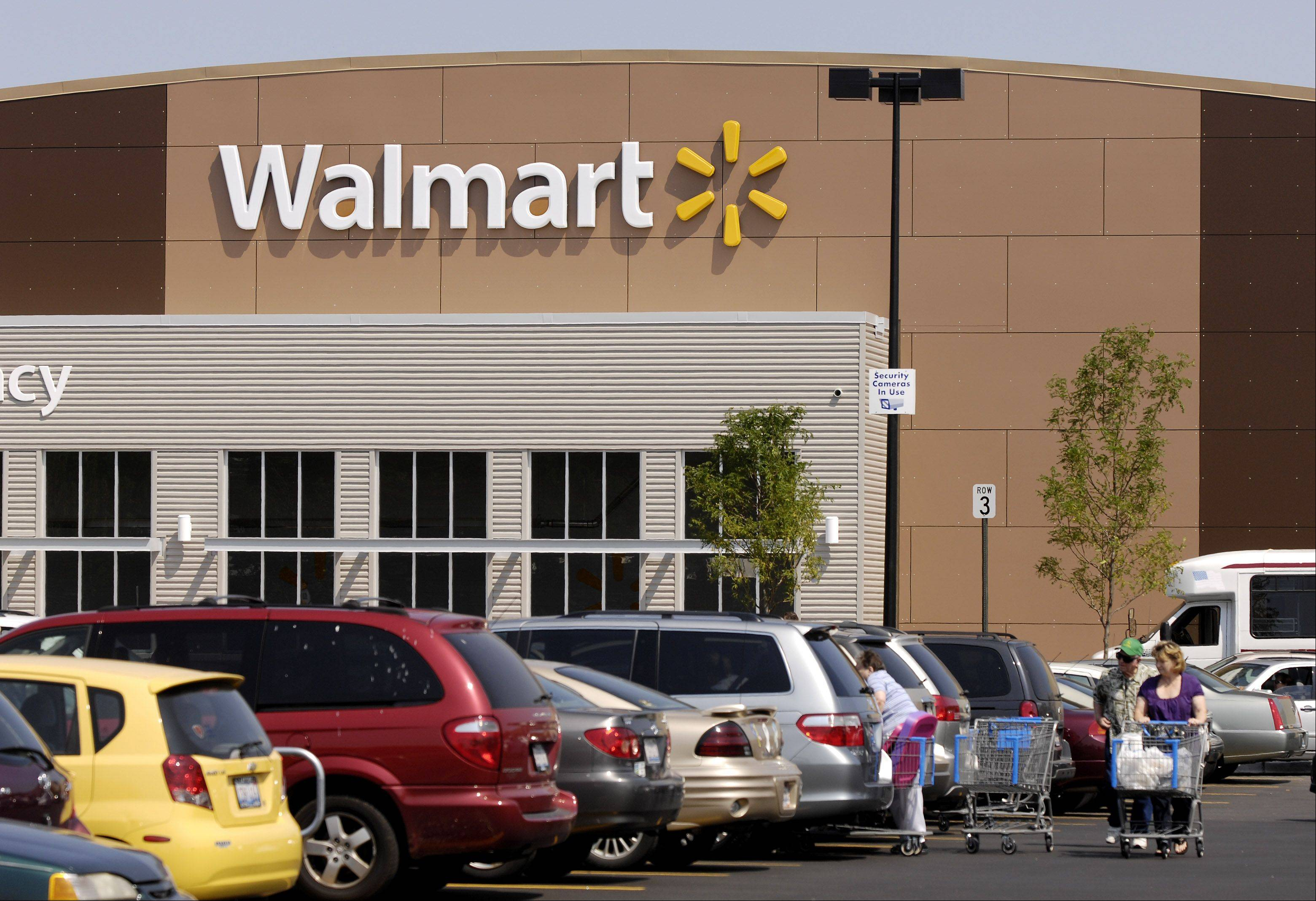 Wal-Mart Stores Inc.'s first quarter profit rose 1.1 percent as the world's largest retailer struggled with a sales slump in its namesake business.