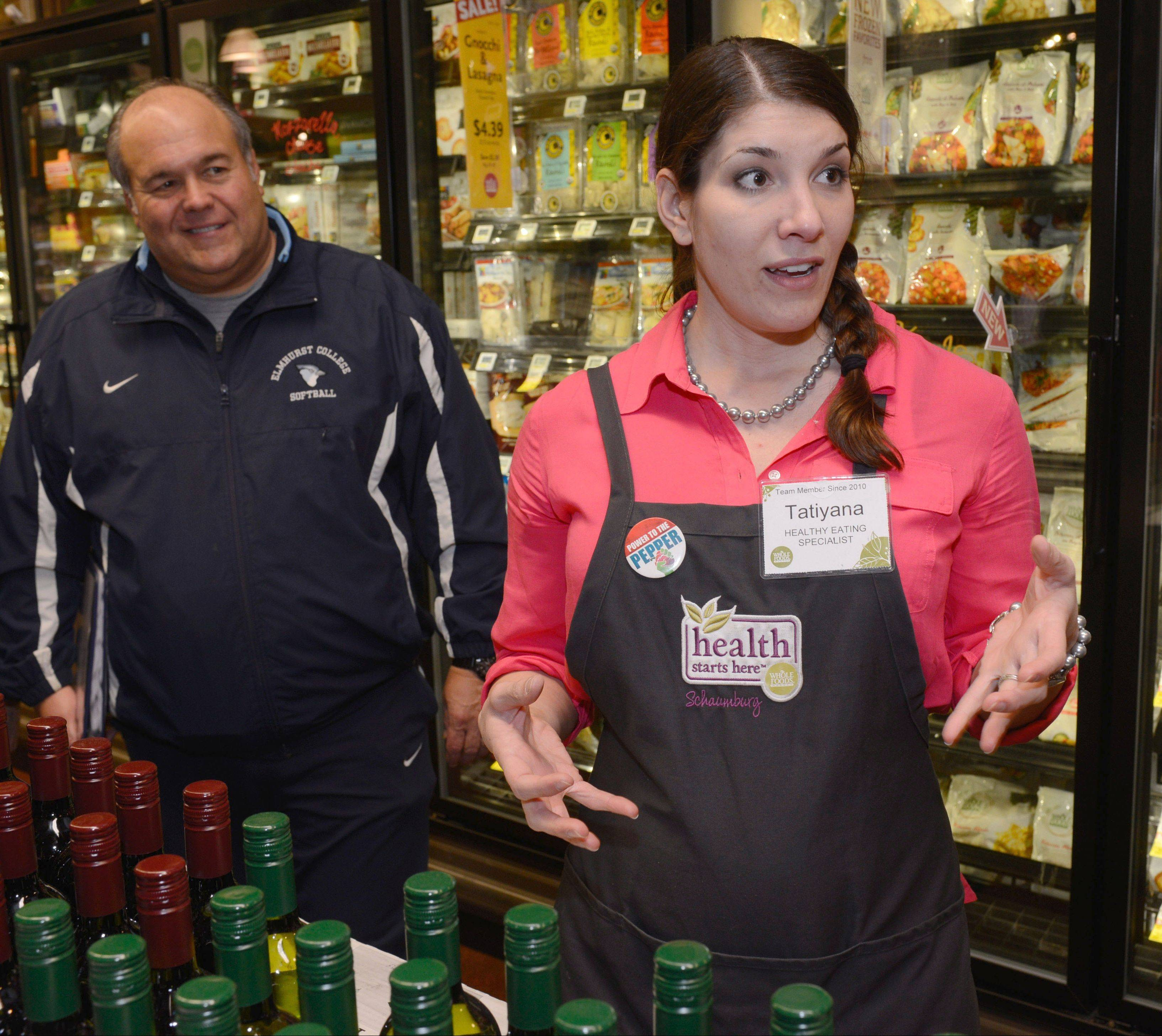 Healthy eating specialist Tatiyana Baukovic discusses food choices with Fittest Loser Contestants at Whole Foods, Schaumburg.