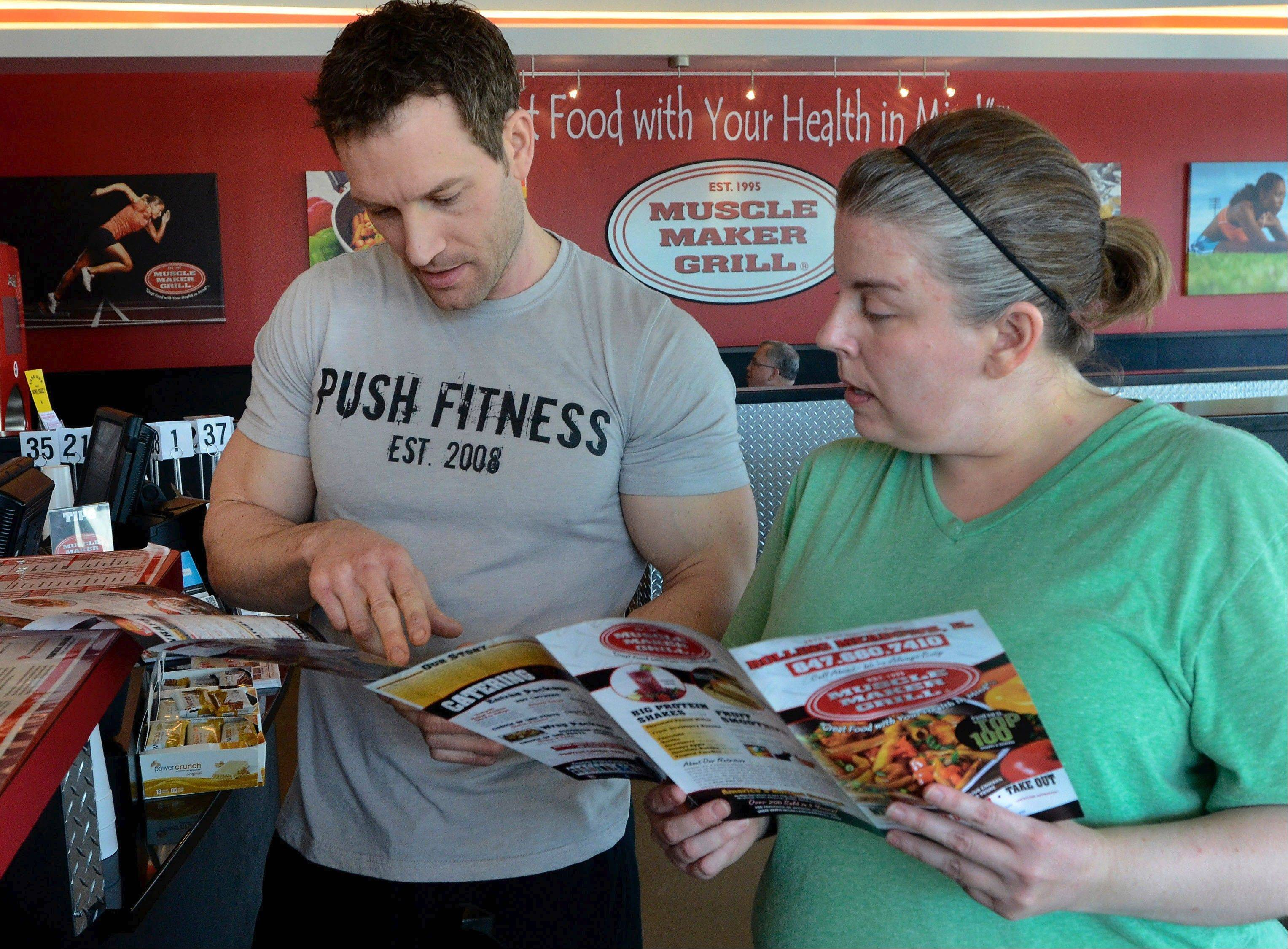 Bob Chwedyk/bchwedyk@dailyherald.comPush Fitness trainer Joshua Steckler and DH participant Melynda Findlay check out Muscle Maker Grill in Rolling Meadows.
