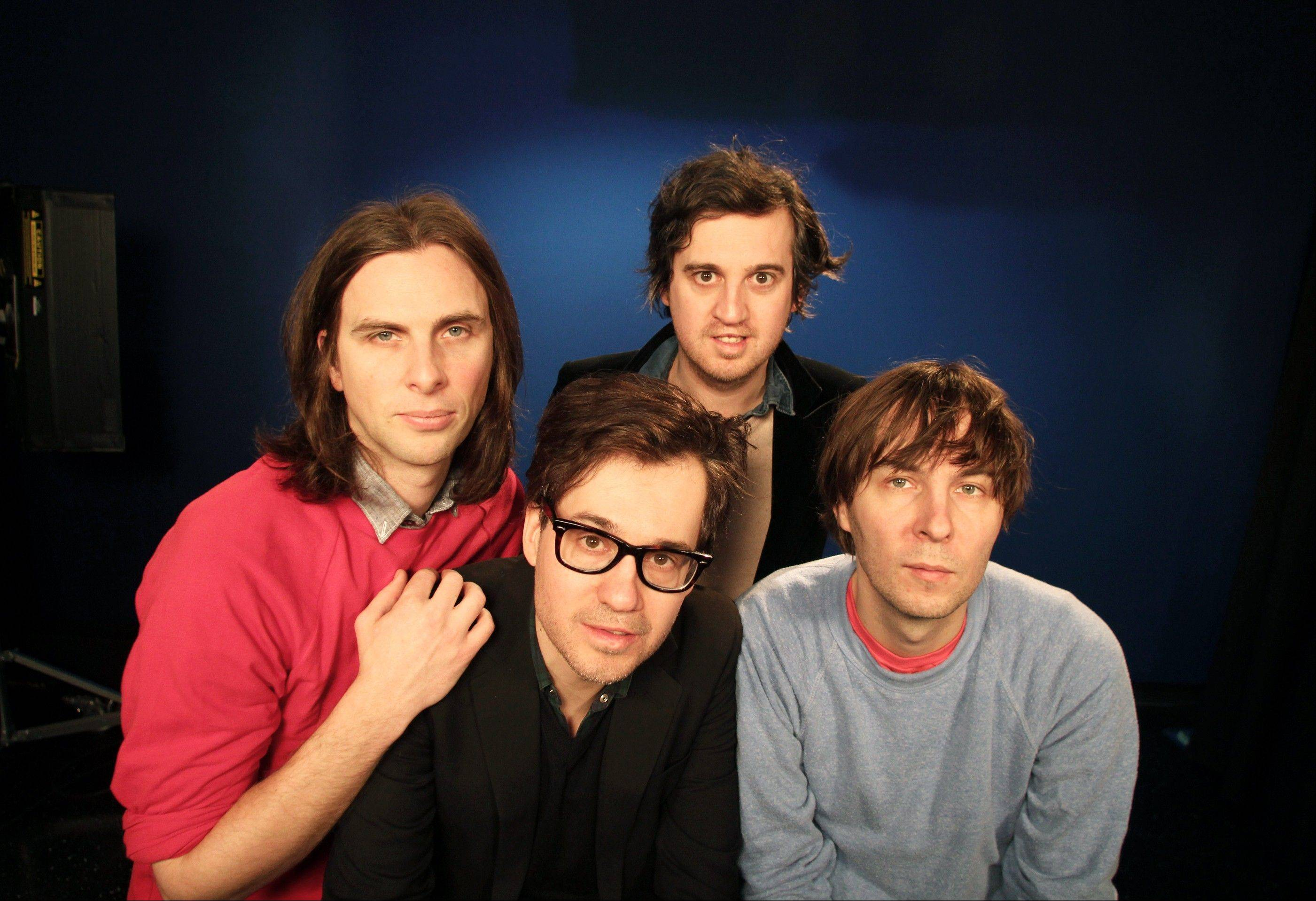 "Members of the band Phoenix, from left, Deck D'arcy, Laurent Brancowitz, Christian Mazzalai and Thomas Mars, pose in New York. Phoenix frontman Thomas Mars said their new album, ""Bankrupt!,"" was born out of the negative influences going on in the band after the unprecedented success of their Grammy-winning 2009 album, ""Wolfgang Amadeus Phoenix."""