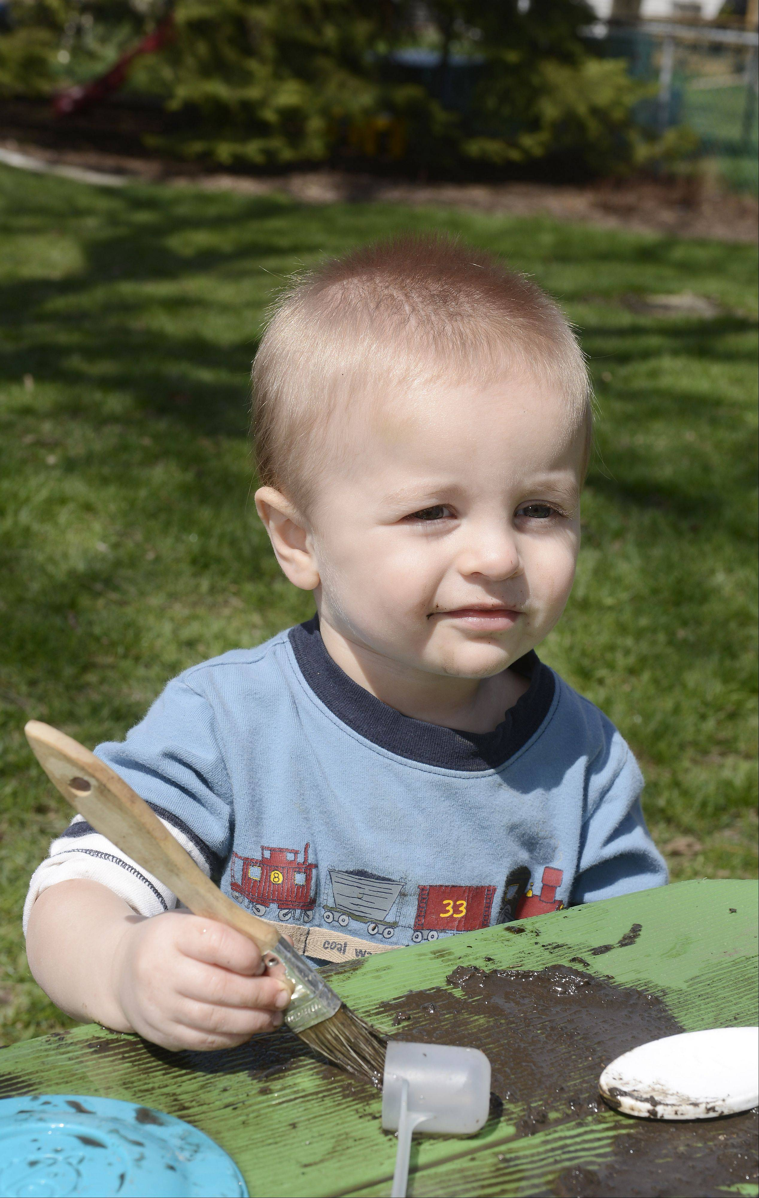 Benjamin Anderson, 1, paints with mud at his parent's Schaumburg home.