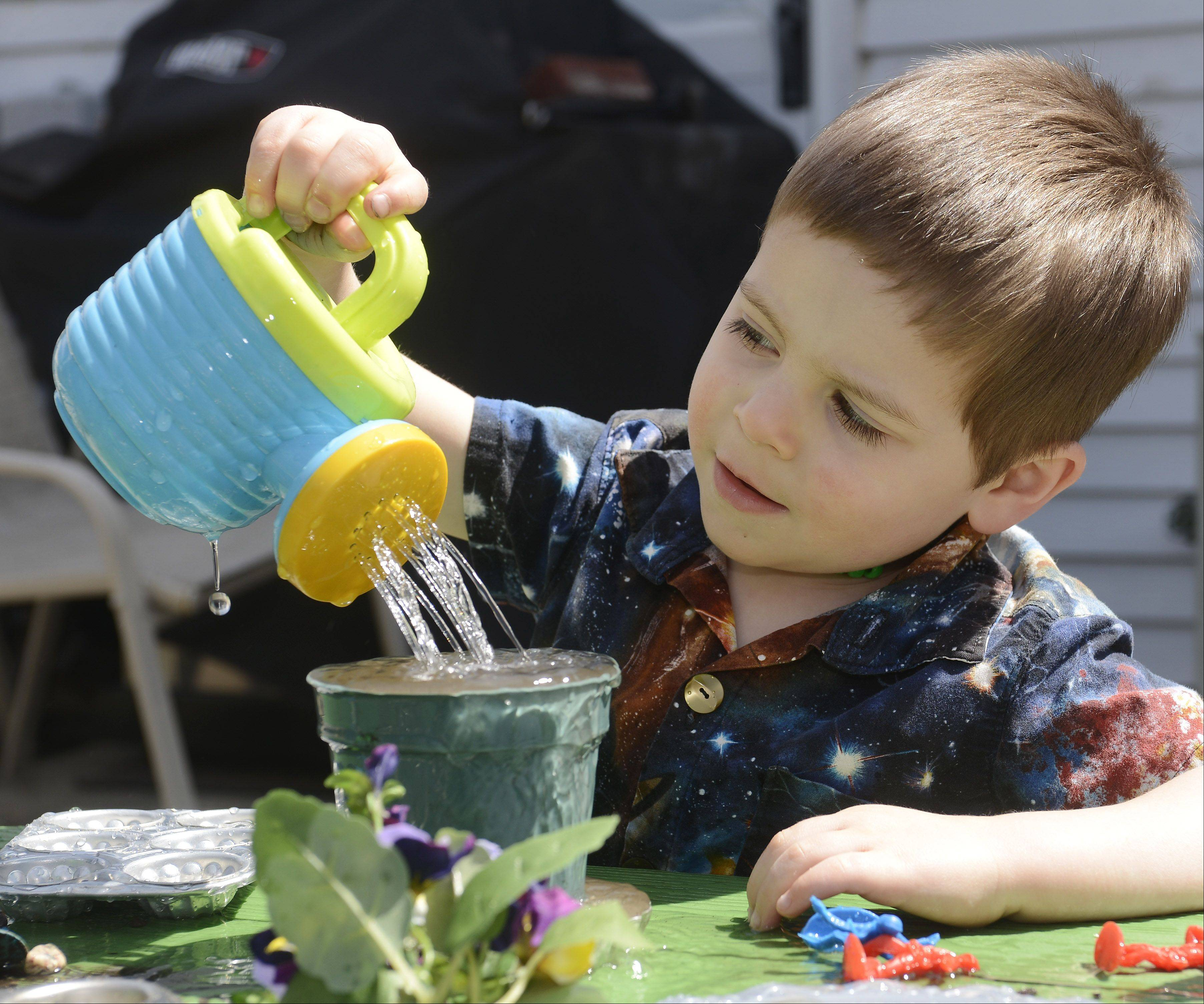 Justin Anderson, 3, combines mud with plenty of water while playing at his Schaumburg home.