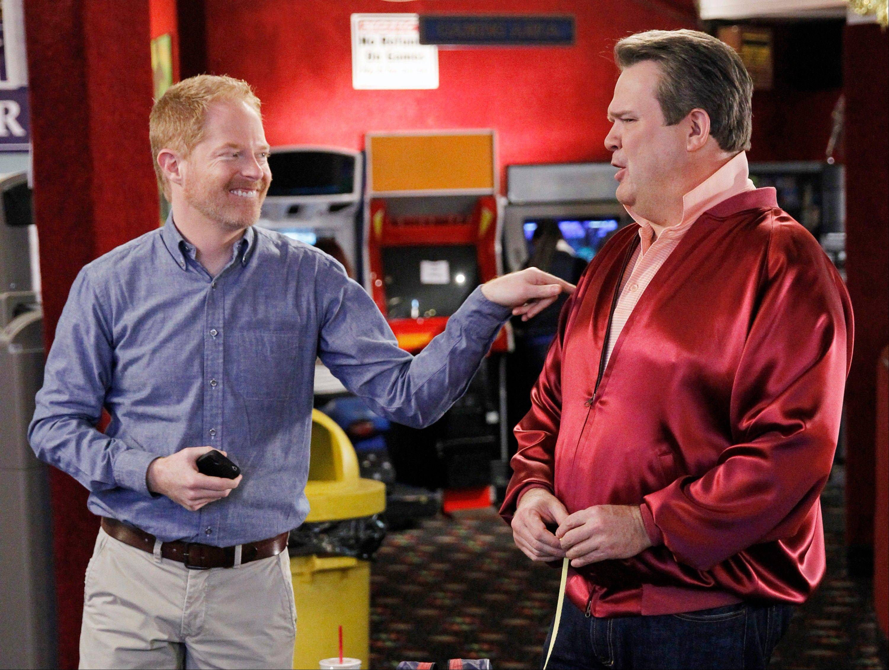 "The ACLU is lobbying for the gay couple -- Eric Stonestreet, right, as Cameron, and Jesse Tyler Ferguson as Mitchell -- on ""Modern Family"" to get married. ACLU Action started a campaign to urge the show's producers to script a wedding episode for Mitchell and Cameron, already fathers of an adopted child and one of three couples at the heart of the show."