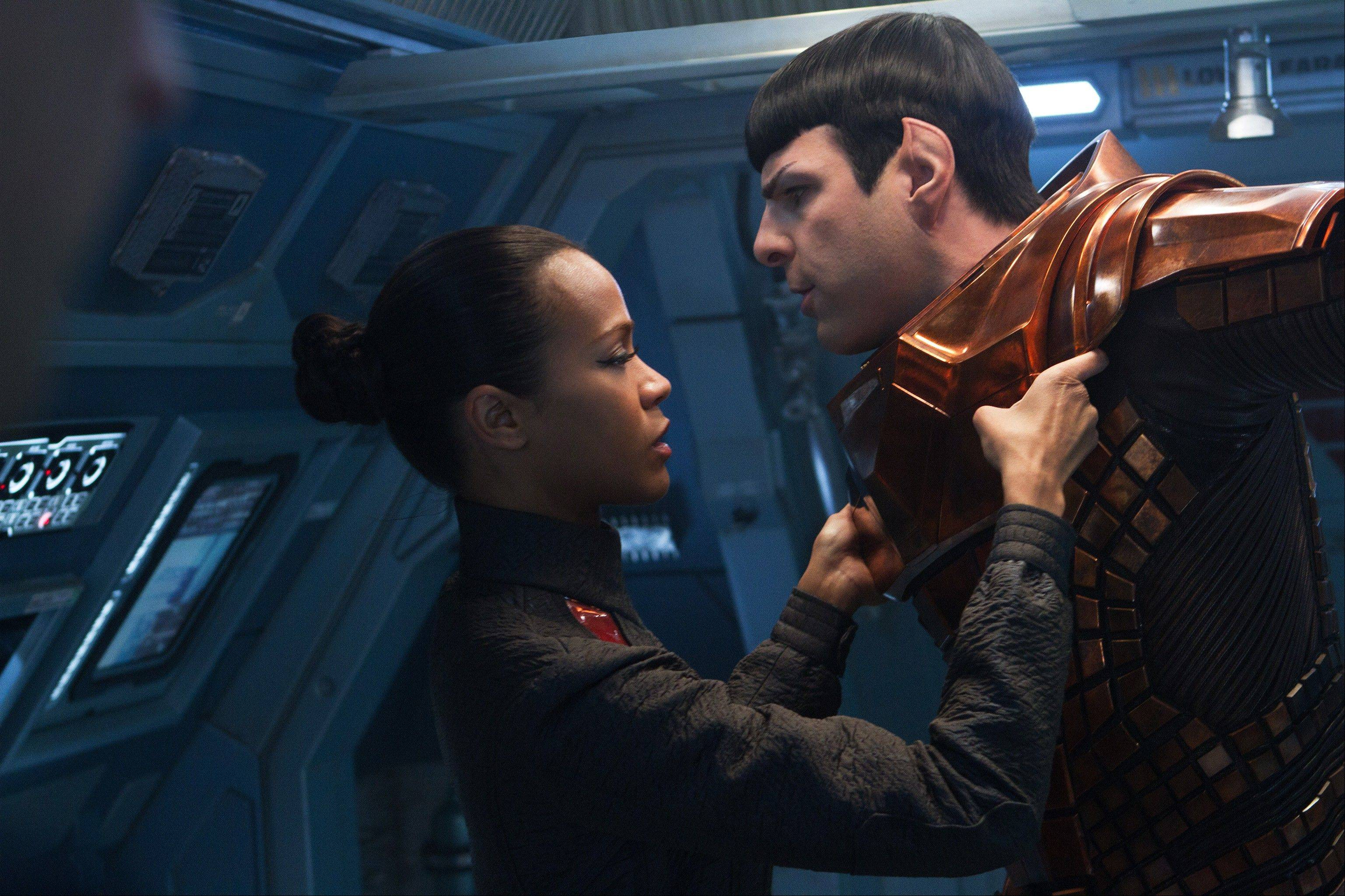 "Uhura (Zoe Saldana) and Spock (Zachary Quinto) face the pitfalls of romance as well as a new enemy in ""Star Trek Into Darkness."""