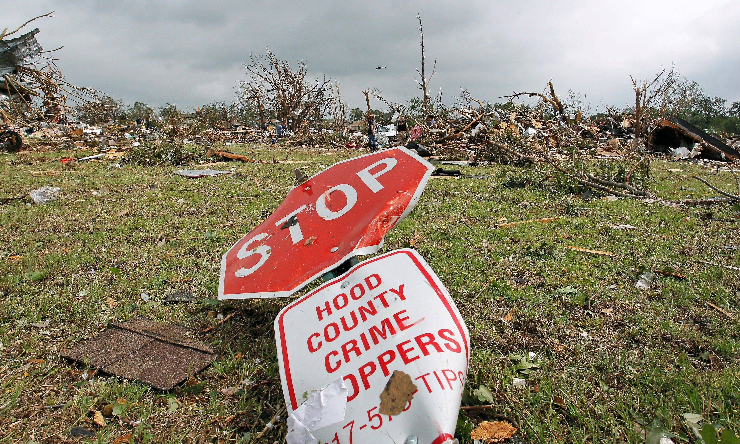 A toppled stop sign lies on the ground in the destroyed Rancho Brazos neighborhood of Granbury, Texas, Thursday, May 16, 2013. Ten tornadoes touched down in several small communities in North Texas overnight, leaving at least six people dead, dozens injured and hundreds homeless. Emergency responders were still searching for missing people Thursday afternoon.
