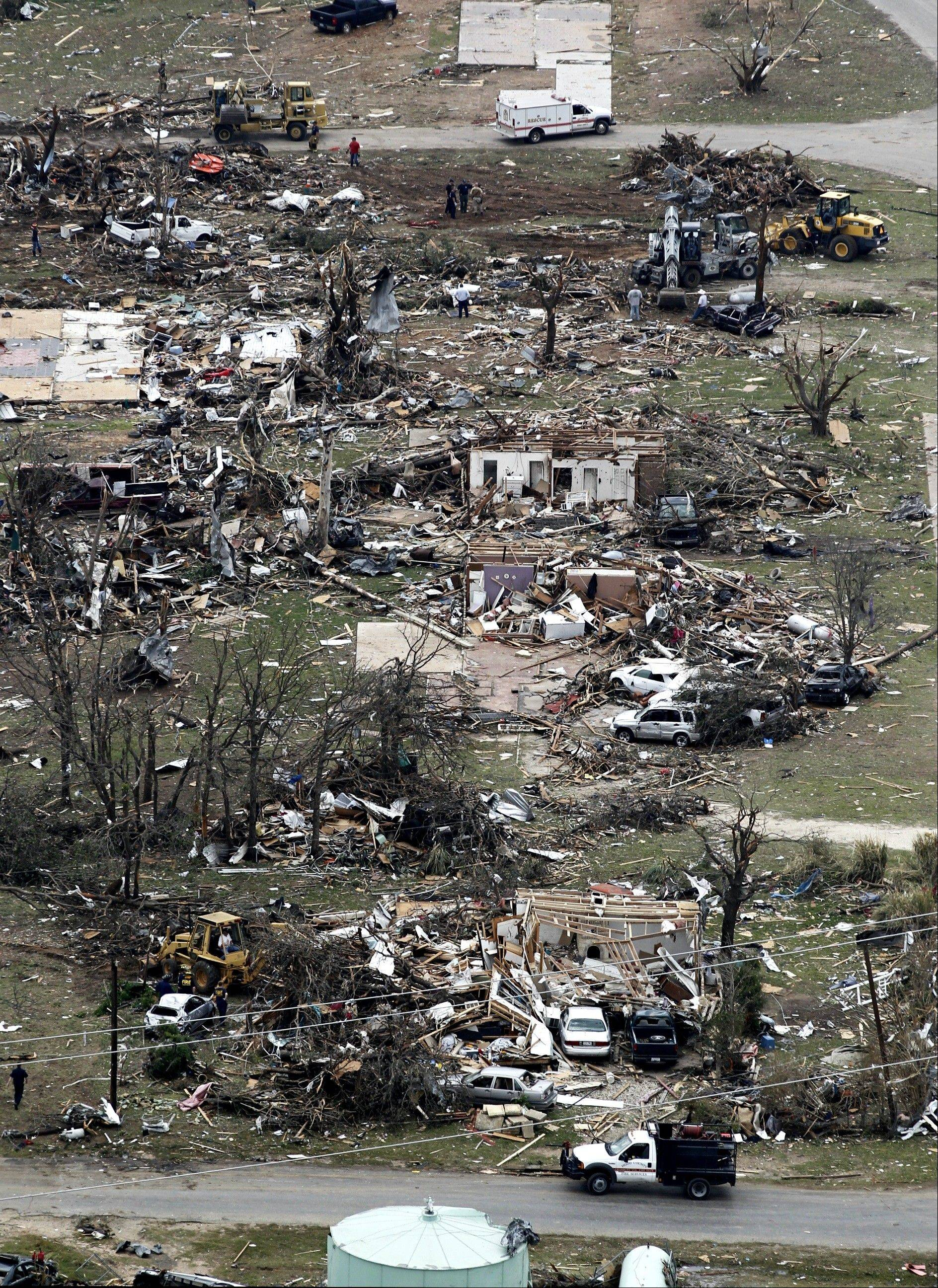Heavily damaged homes are seen in Granbury, Texas, on Thursday, May 16, 2013. Ten tornadoes touched down in several small communities in North Texas overnight, leaving at least six people dead, dozens injured and hundreds homeless.