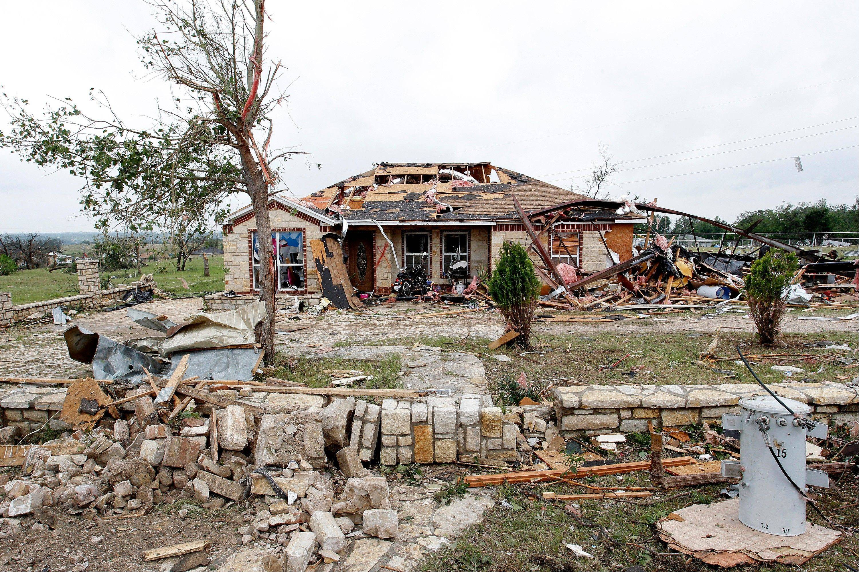 Homes, trees, landscaping, fences, and anything in the path of the tornado is destroyed in the Rancho Brazos neighborhood of Granbury, Texas, Thursday, May 16, 2013. A rash of tornadoes slammed into several small communities in North Texas overnight, leaving at least six people dead, dozens more injured and hundreds homeless.