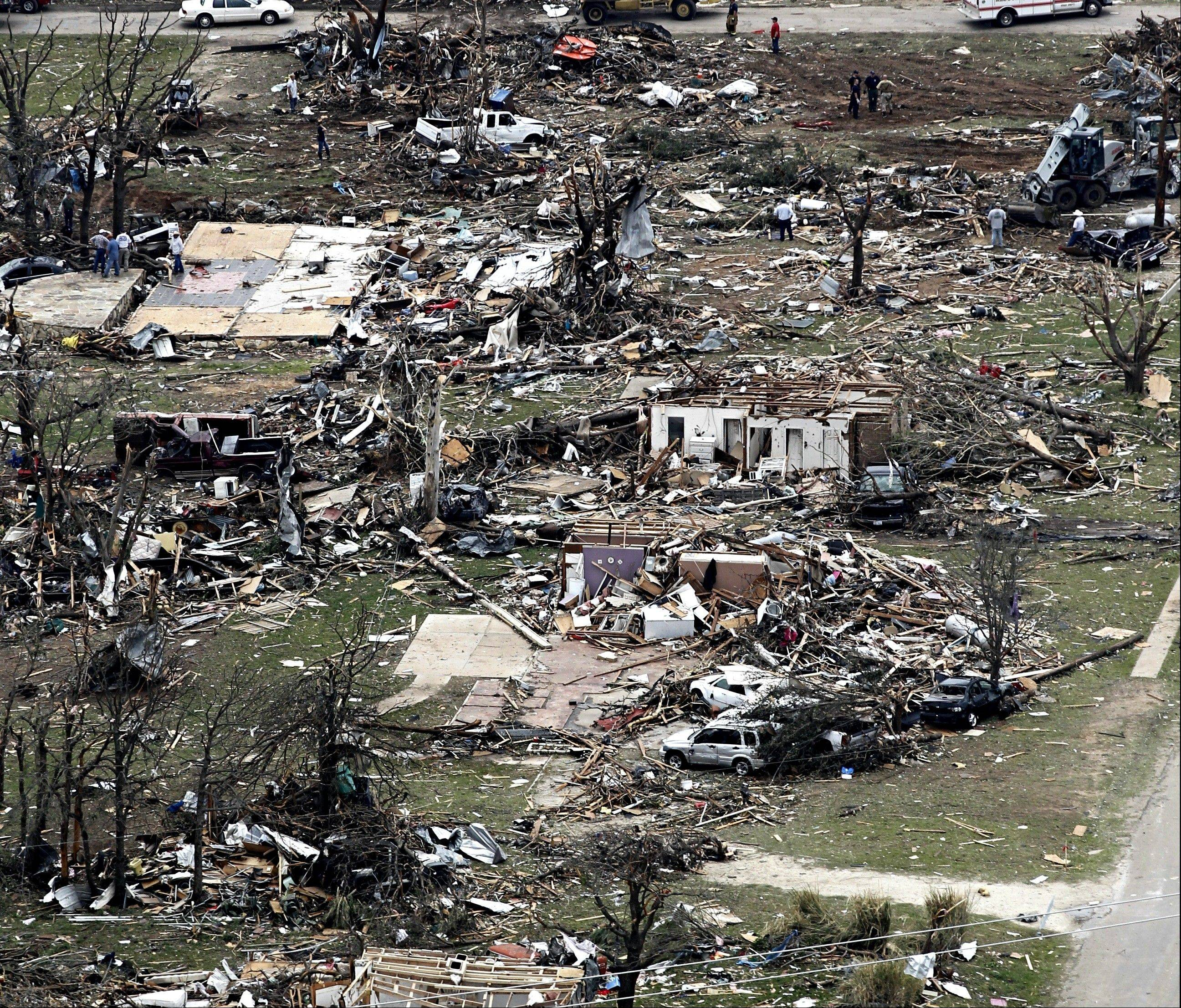 Homes are heavily damaged in this aerial view of Granbury, Texas on Thursday, May 16, 2013, after multiple tornadoes hit the area Wednesday night. Ten tornadoes touched down in several small communities in North Texas overnight, leaving at least six people dead, dozens injured and hundreds homeless. Emergency responders were still searching for missing people Thursday afternoon.