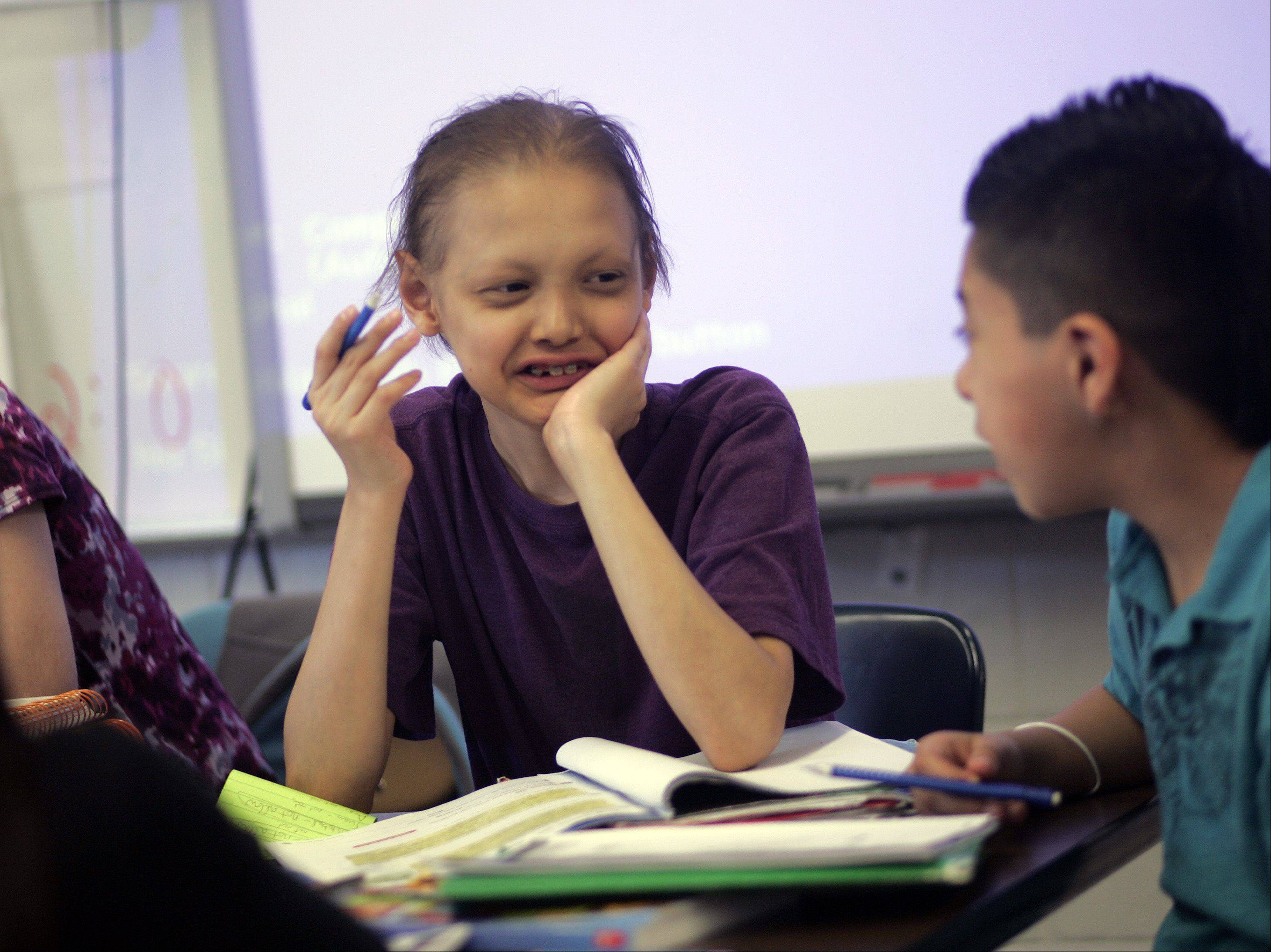 Eduardo Lopez Soriano, a fifth-grader from Lakewood School in Carpentersville, shares a laugh with one of his classmates.
