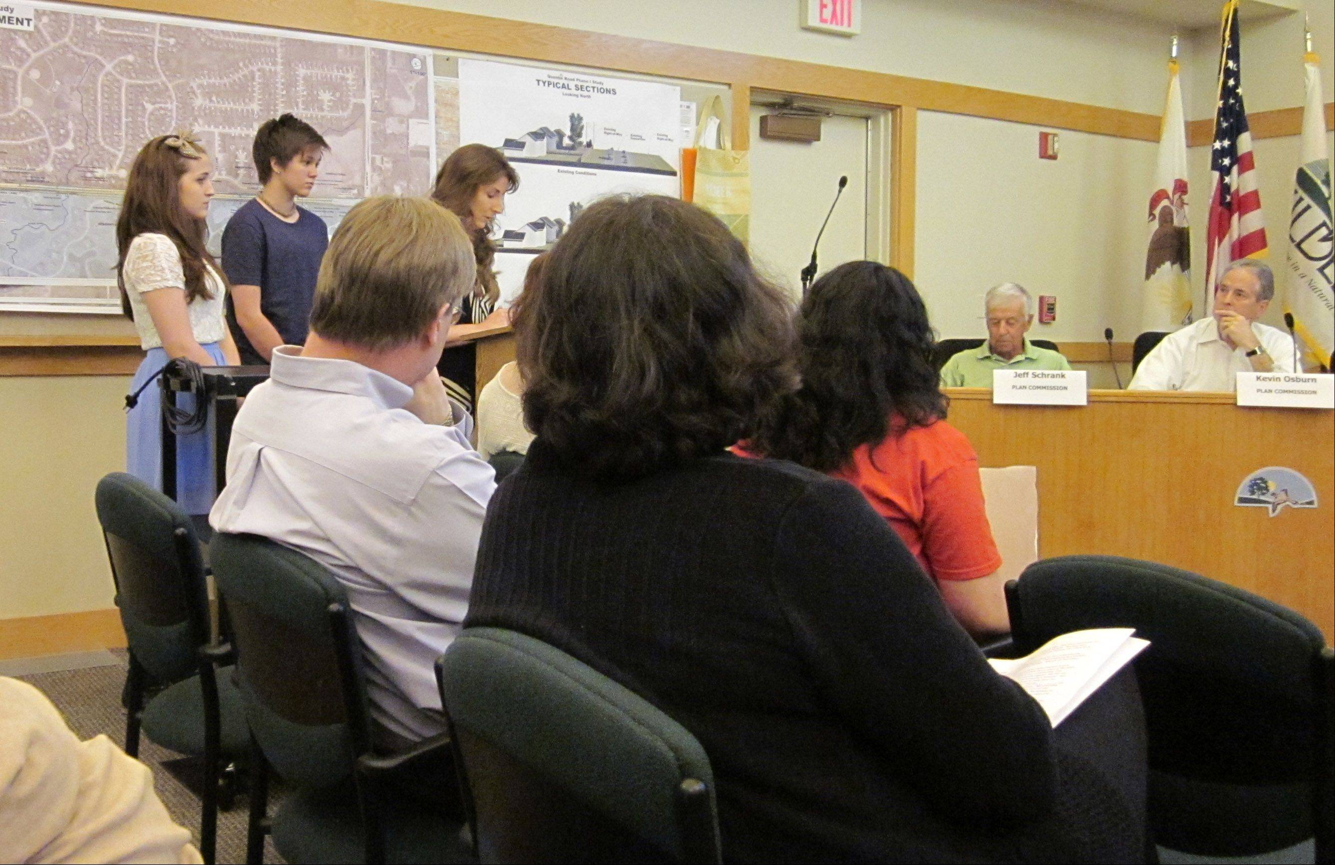 Spectators at Tuesday's Kildeer plan commission meeting listen as Donna LaJeunesse of Lake Zurich speaks against a Chick-fil-A restaurant proposed for the former Muddy Paws shelter site on Rand Road.