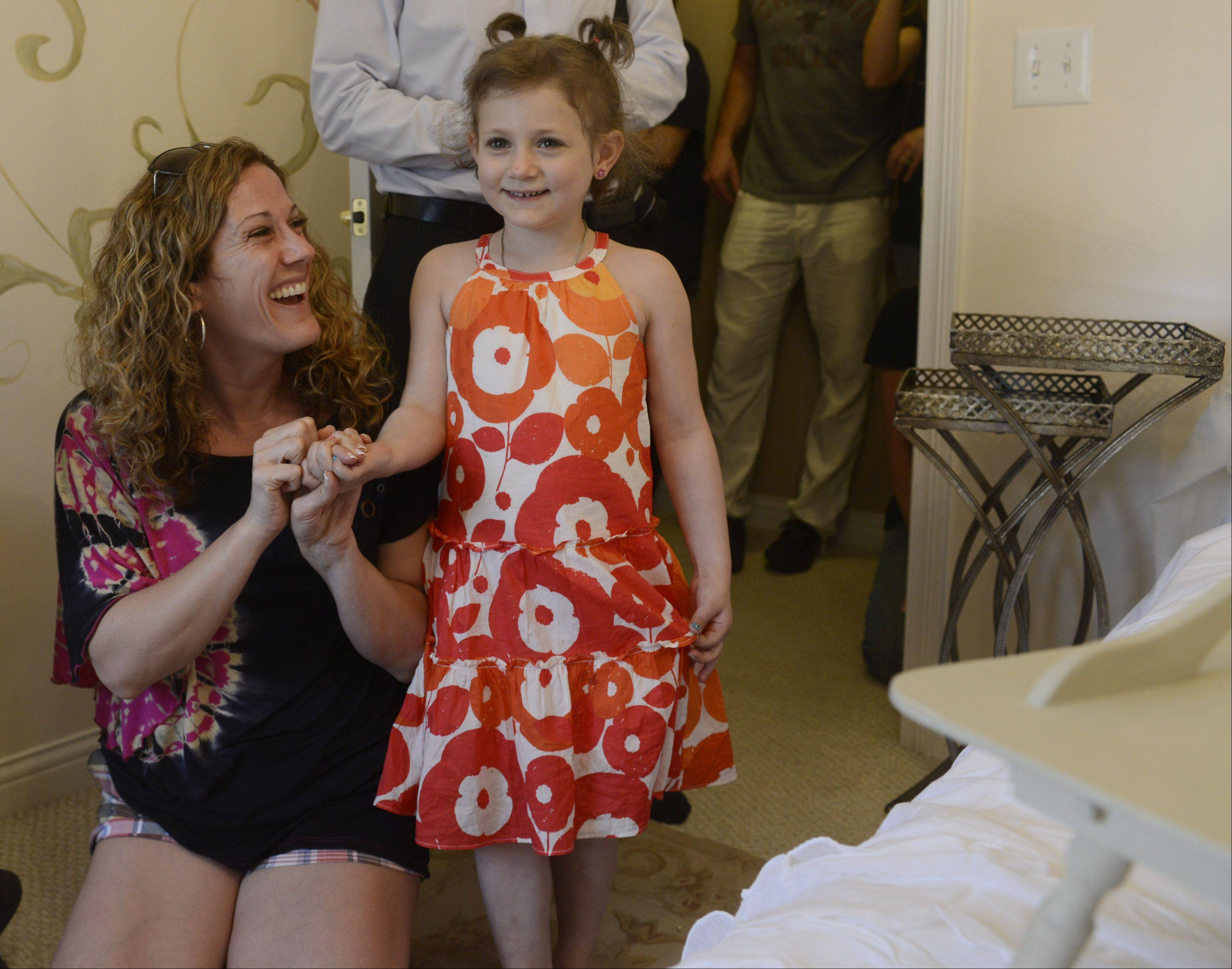 Kennedy Khalimsky, 6, of Palatine and her mom, Edan Gelt, react to the bedroom makeover provided by the new Chicago-area chapter of Special Spaces National. Kennedy has been diagnosed with leukemia and is undergoing treatment.
