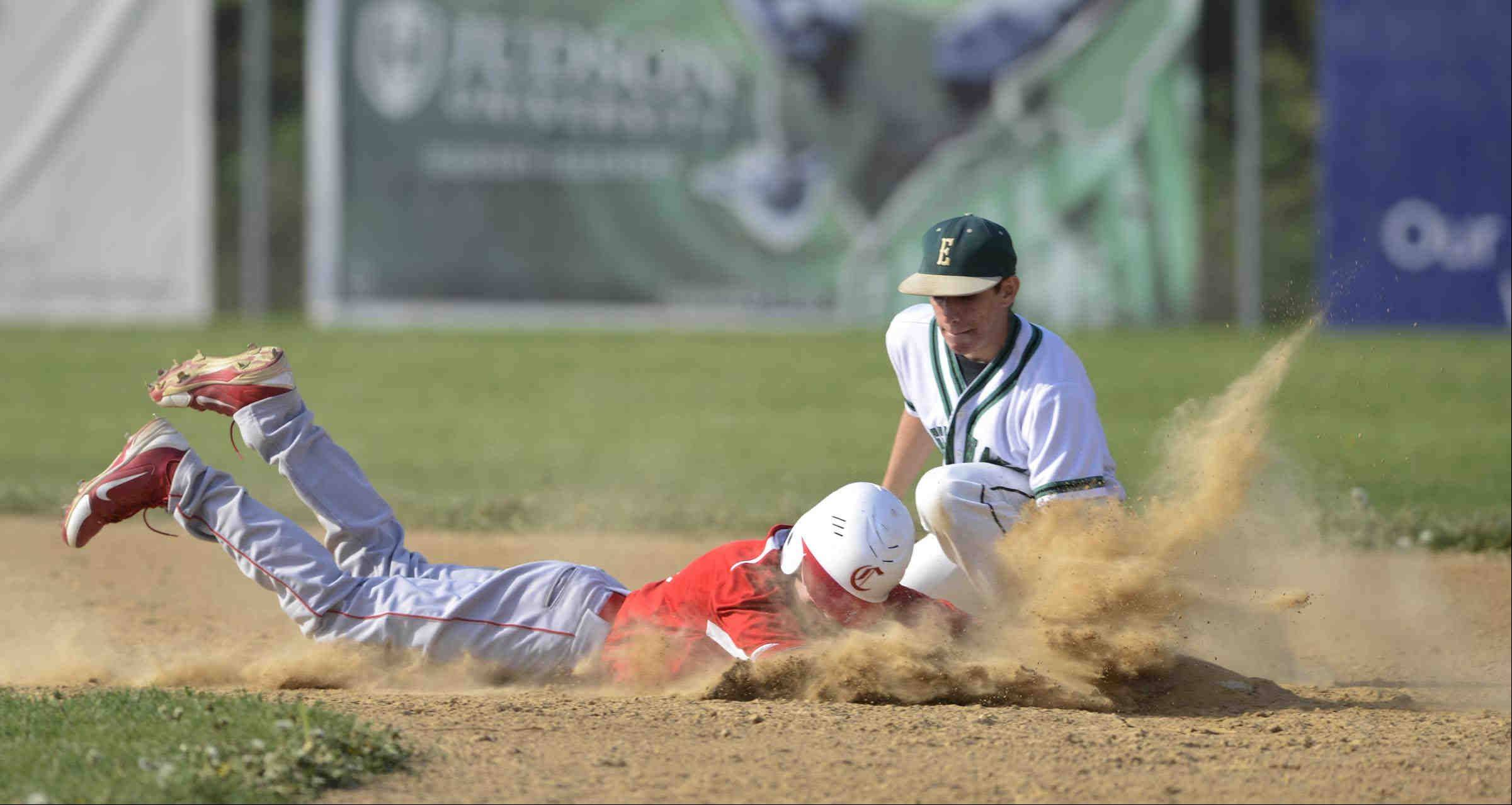 Aurora Christian's Ian Livingston dives into the dirt to reach second base safely as St. Edward shortstop Antonio Domel reaches in to tag him on the pick off play Thursday in the 2A Regional game in Elgin.