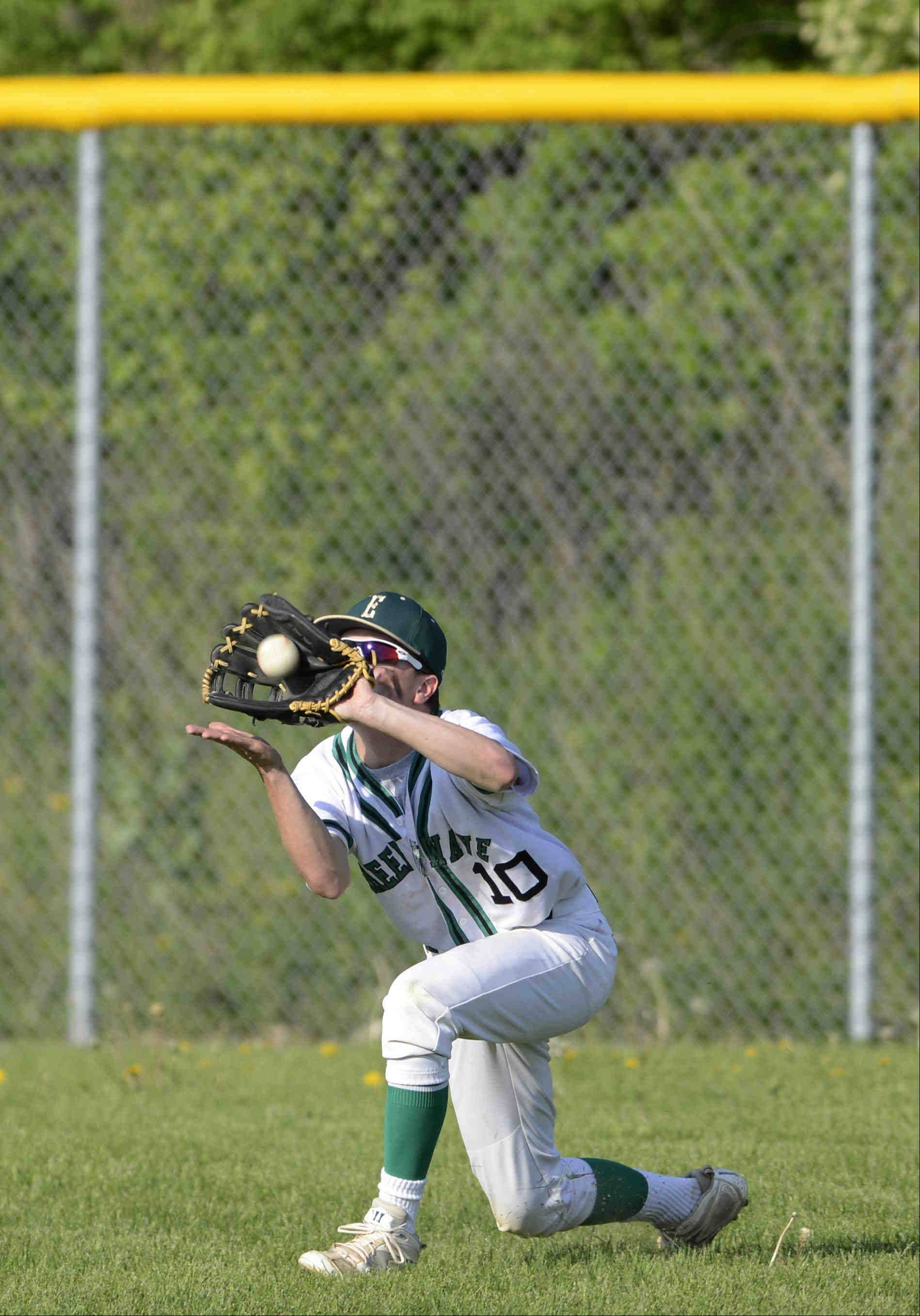 St. Edward right fielder Kevin Lamp secures a line drive from Aurora Christian's Ian Livingston for the first out of the last inning Thursday in the 2A Regional game in Elgin.