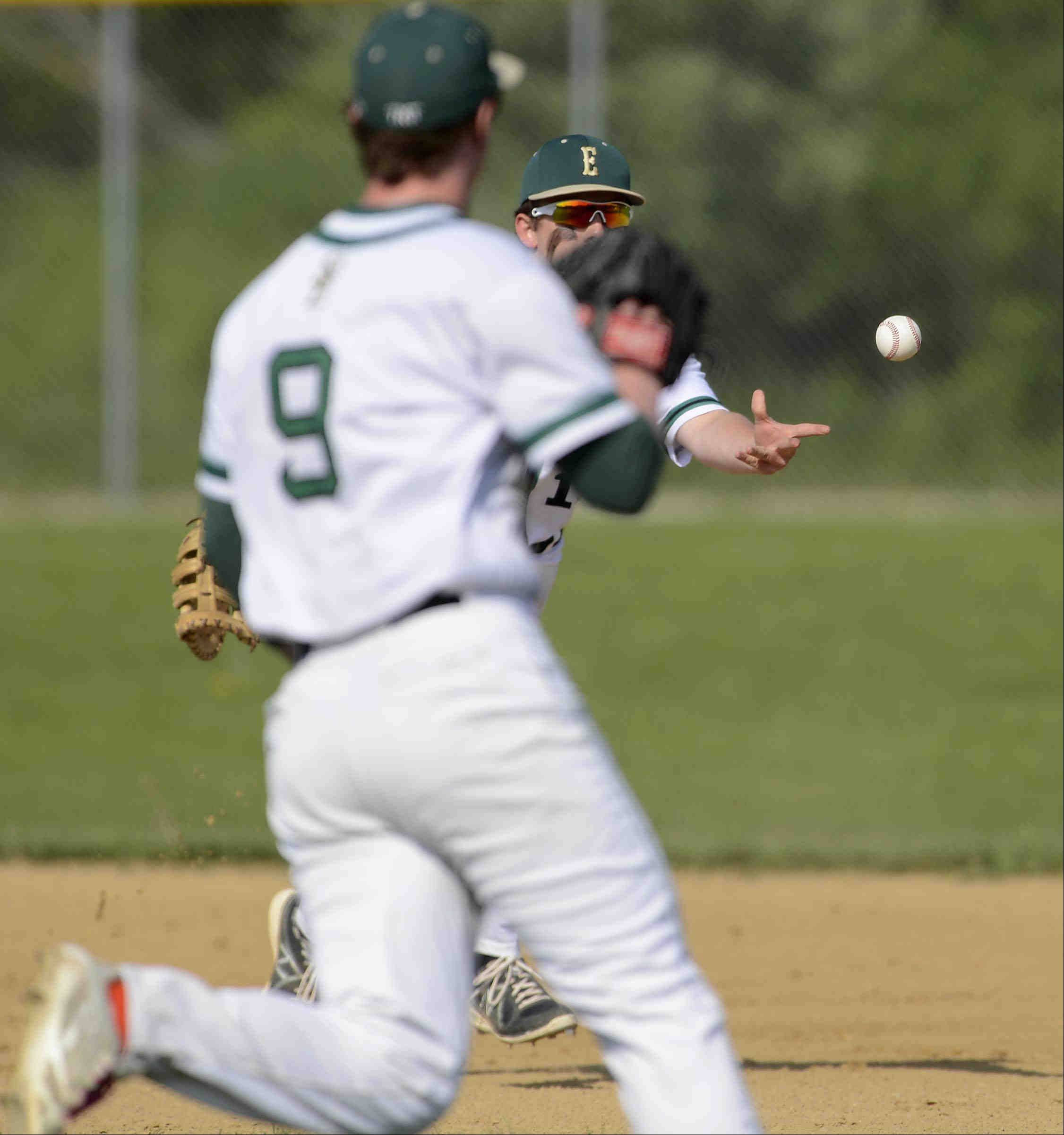 St. Edward's first baseman Jake Lafrenz tosses the ball to pitcher Jacob Koehring as he covers first base to force out Aurora Christian's J.T. Baksha in the second inning Thursday in the 2A Regional game in Elgin.