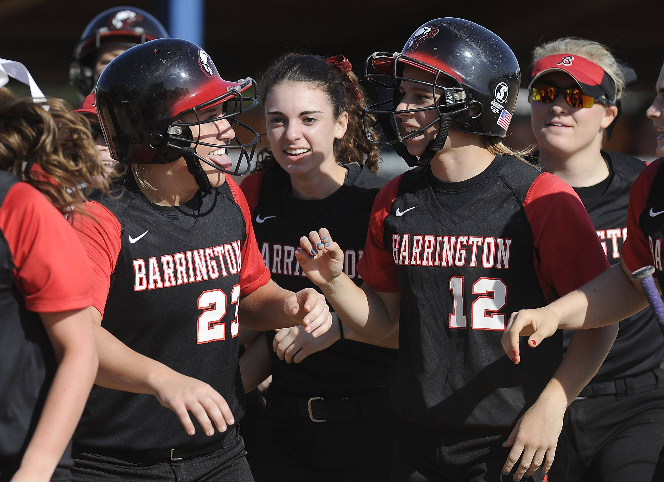 Barrington's Tess Bolger, left, celebrates her first-inning home run over the left field fence against Buffalo Grove in the MSL championship game at Buffalo Grove on Thursday.