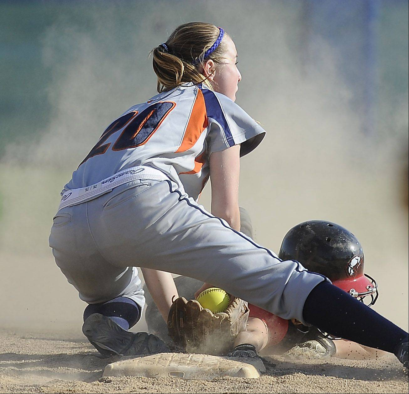 Buffalo Grove's Dea Barton puts the tag on Barrington's Jenna Privatsky as she slid past second base in the MSL championship game at Buffalo Grove on Thursday.