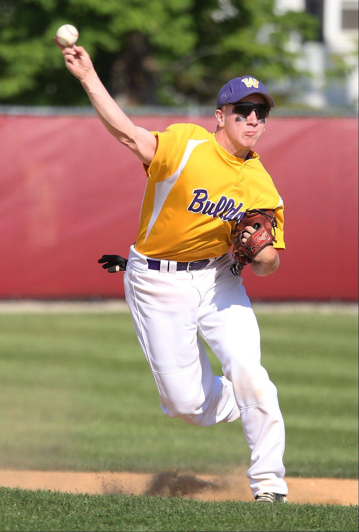 Wauconda shortstop Brandon Gibis throws to first base during the North Suburban Conference championship game Thursday at Mundelein.