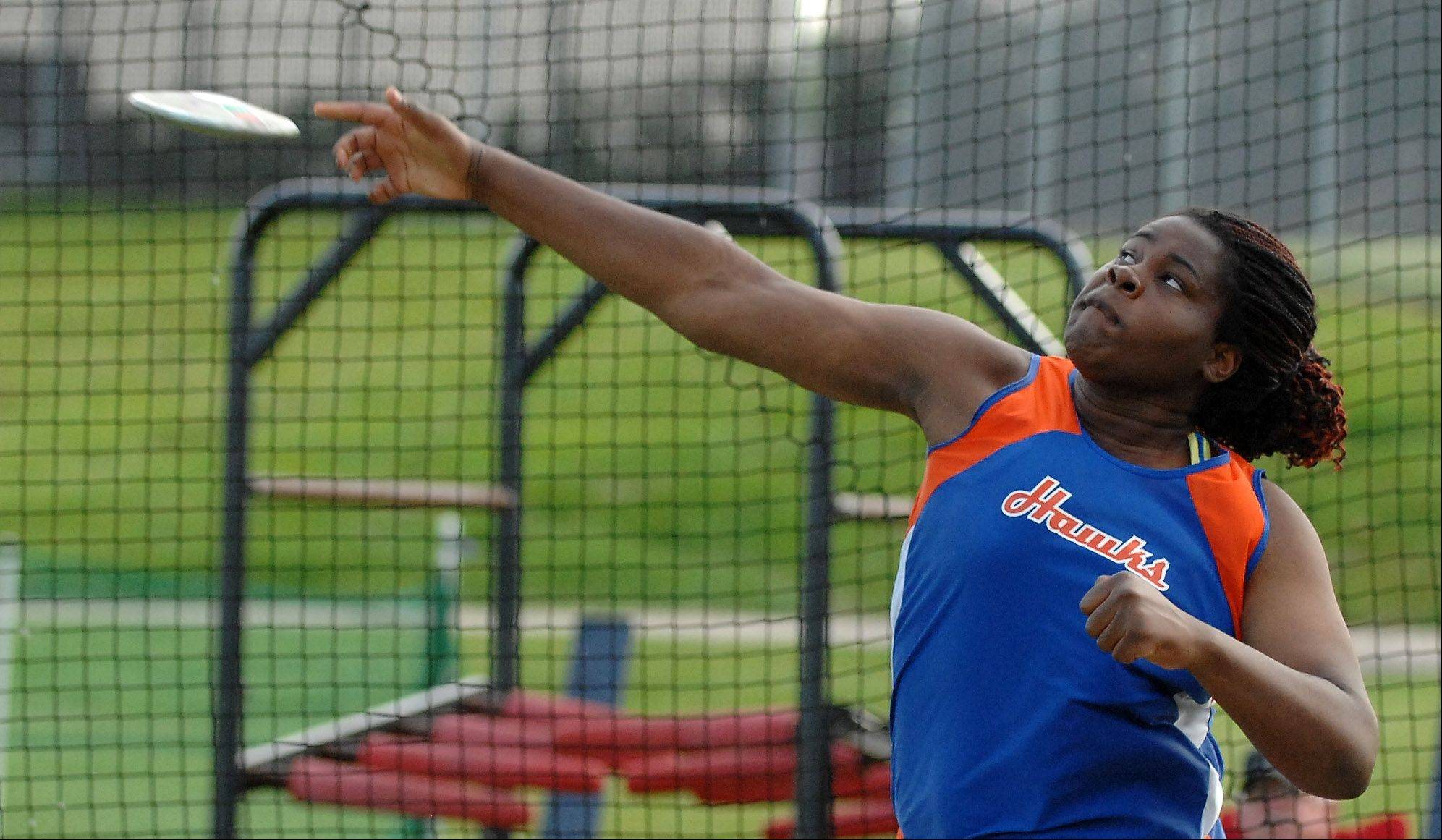 Hoffman Estates' Banke Oginni, shown here in last season's state meet, is in the thick of things for another medal performance this weekend.