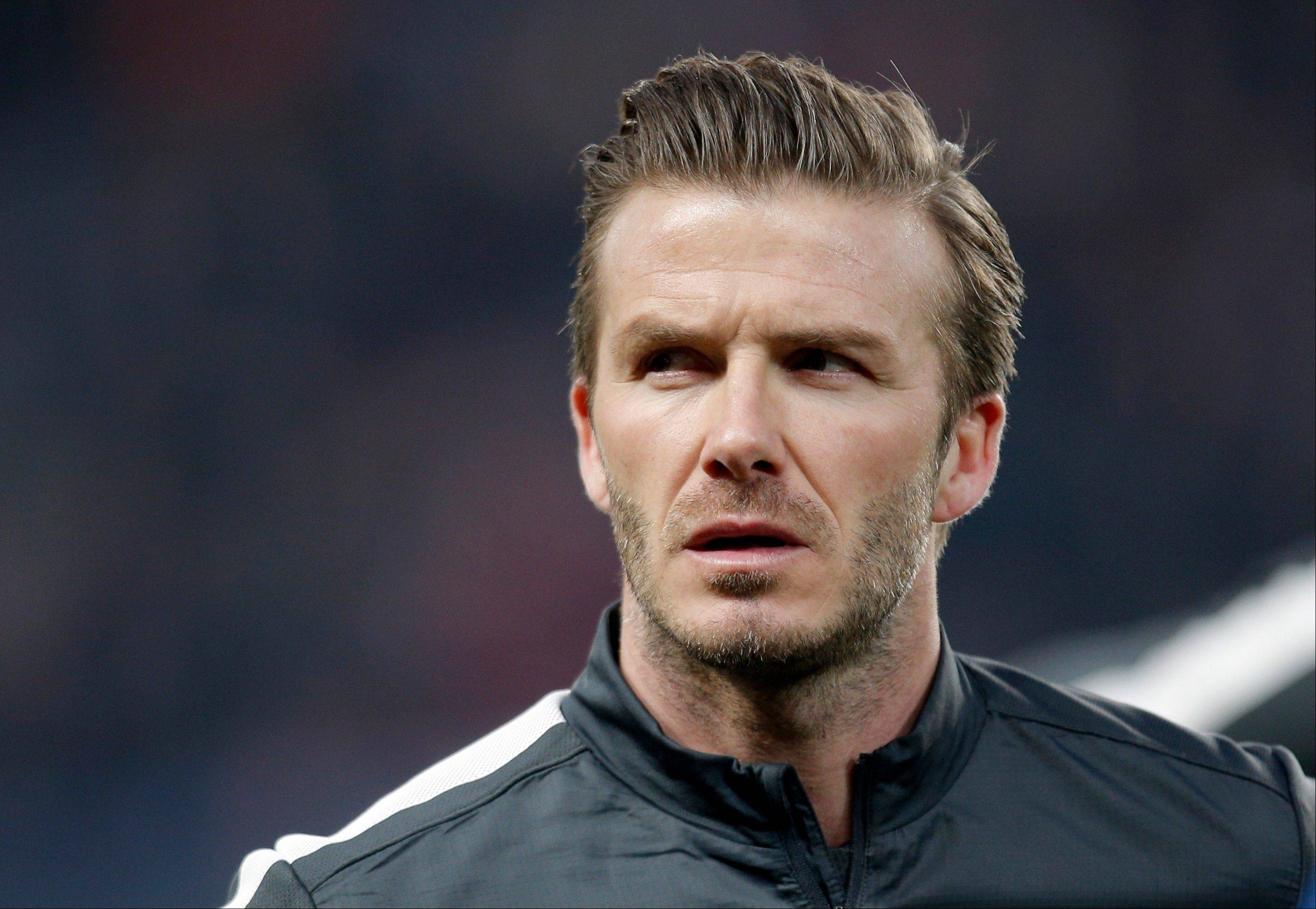 Paris Saint Germain's David Beckham arrives for his Champions League quarterfinal soccer match against Barcelona in Paris. Beckham is retiring from soccer after the season. The 38-year-old Englishman recently won a league title in a fourth country with Paris Saint-Germain.