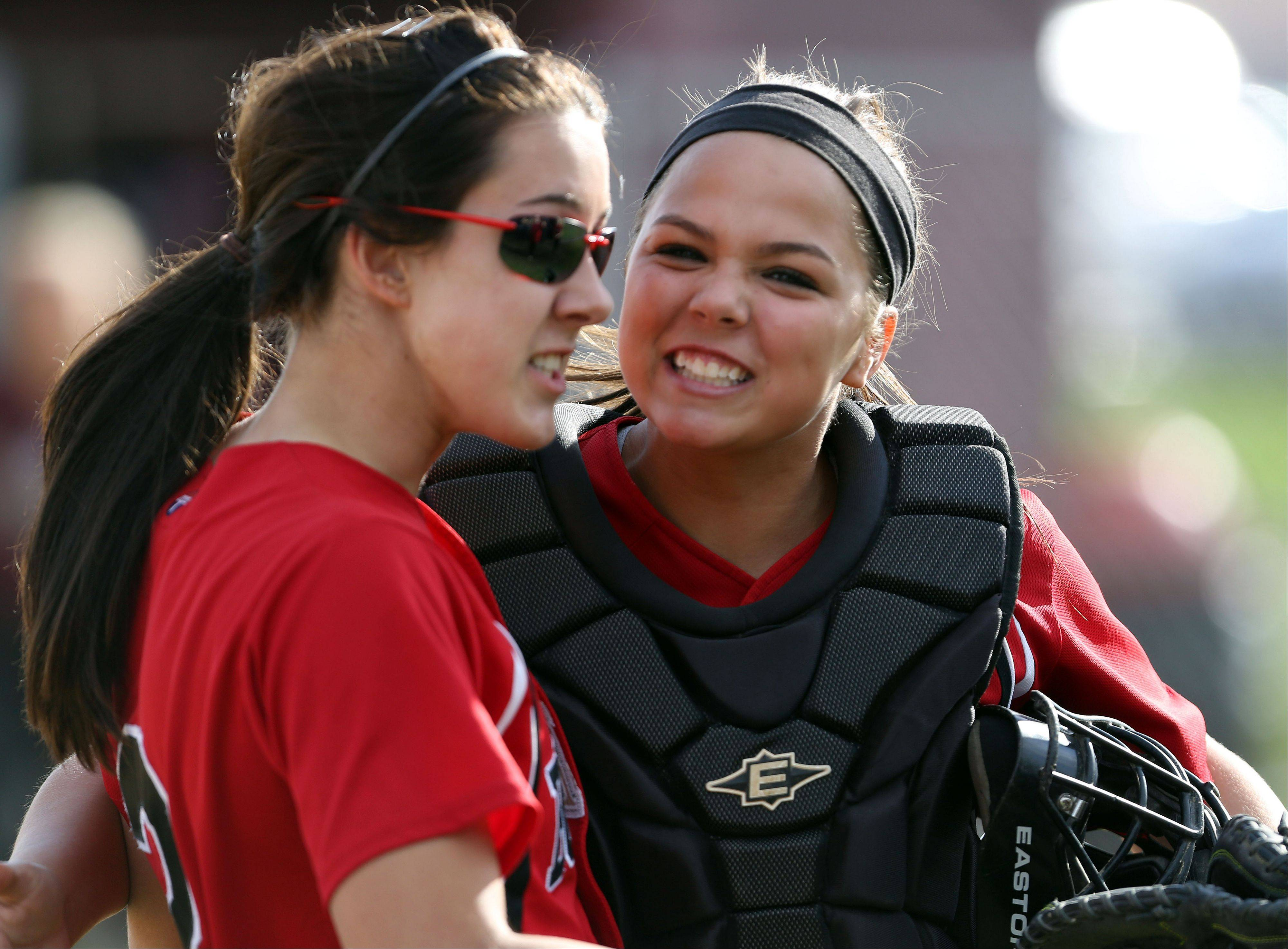 Grant catcher Kayla Uhwat, right, celebrates with pitcher Caitlyn Moran during the NSC championship game Wednesday at Zion-Benton.