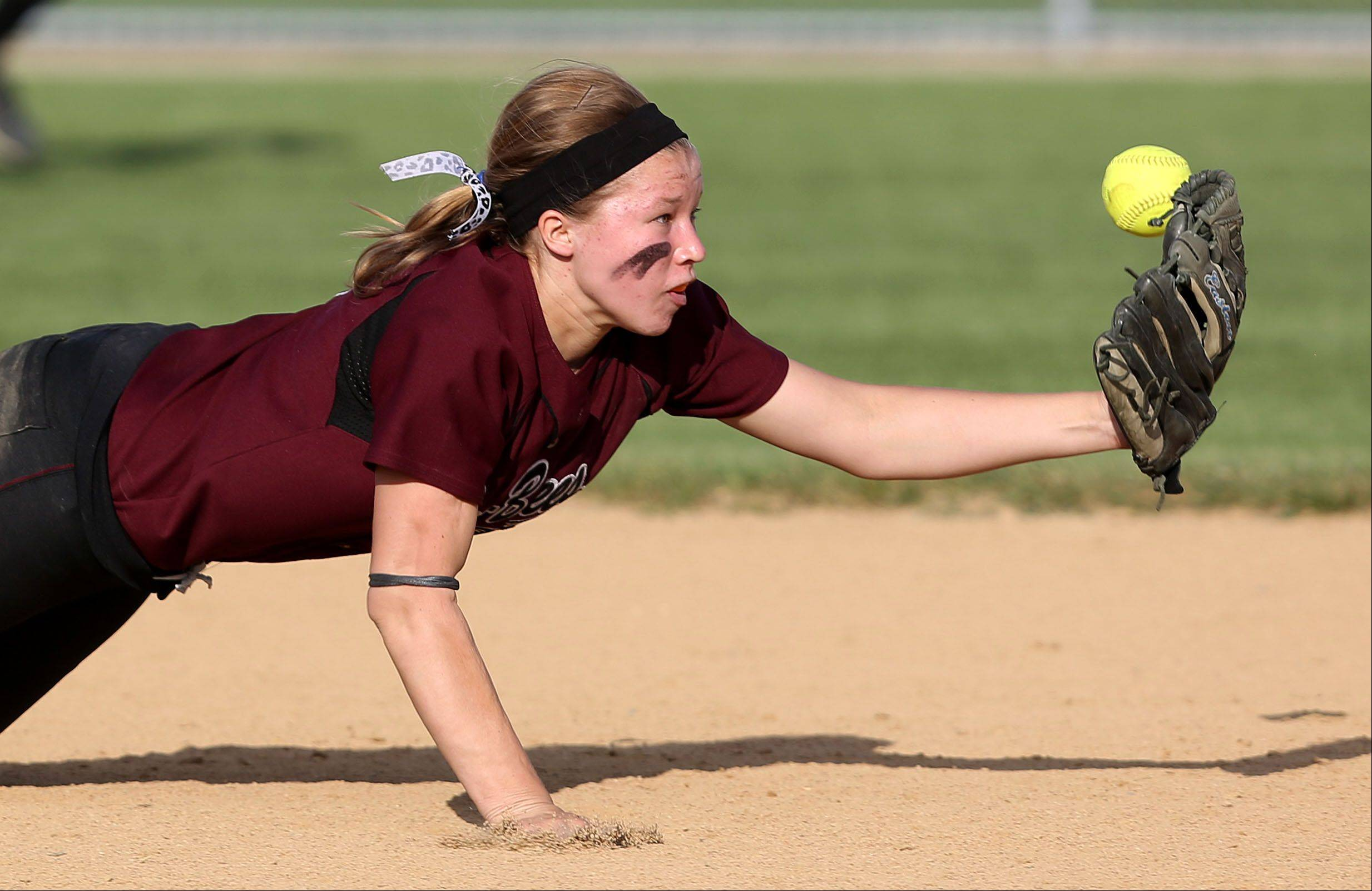 Zion-Benton's Janie Torola makes a diving attempt at a hard-hit ground ball; the play resulted in the first run of the NSC championship game against Grant at Zion-Benton on Wednesday.