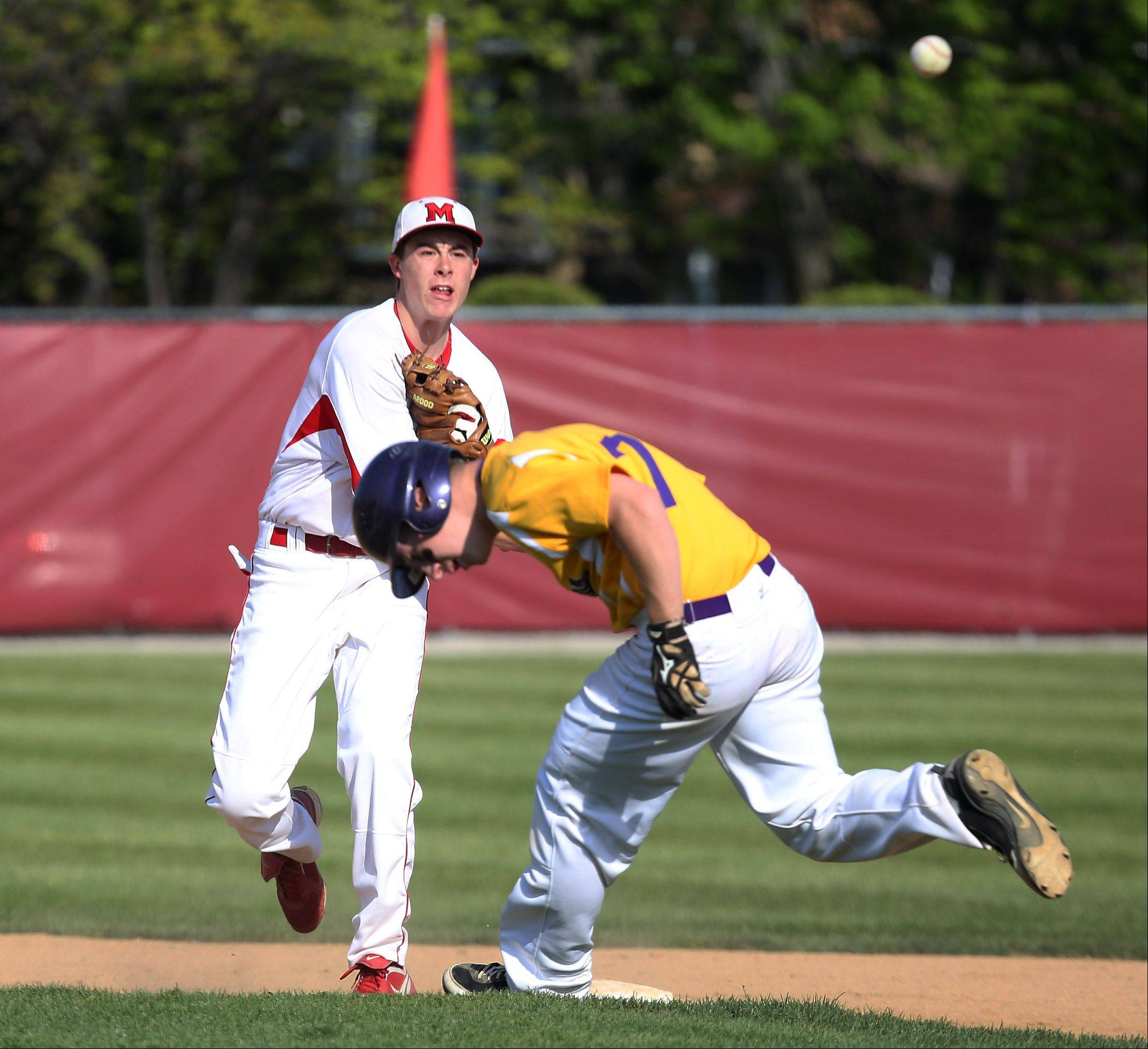 Mundelein infielder Derek Parola turns the double play as Wauconda's Brandon Gibis runs to second base in the fourth inning of the North Suburban Conference championship game Thursday at Mundelein.