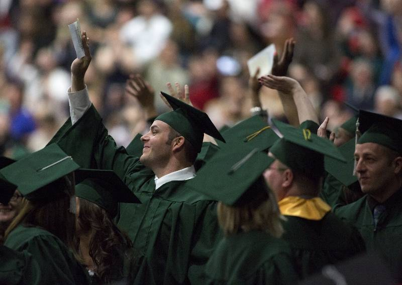 College of DuPage Outstanding Graduates Alexis Reisch of Bolingbrook and Meghan Thome of Naperville encouraged their fellow graduates to find their motivation and never give up during the College's 46th annual Commencement.
