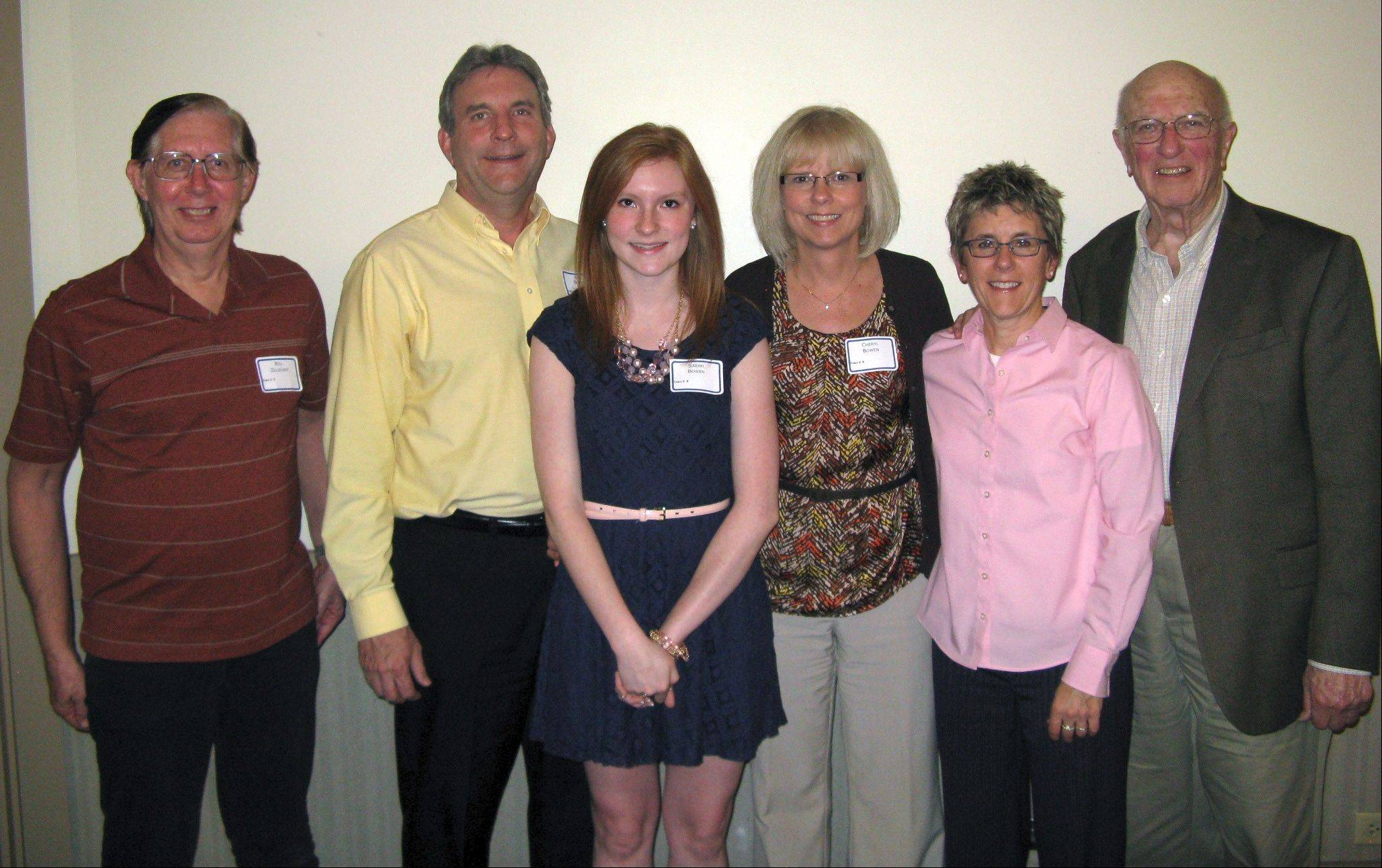 Dundee-Crown High School student Sarah Bowen, who was awarded a $1,500 scholarship by the Dundee Township Visitor's Center, stands with her parents, Bill and Cheryl Bowen, center, market manager Bill Zelsdorf, left, board secretary Paula Lauer, and board member Herbert Beck, right.