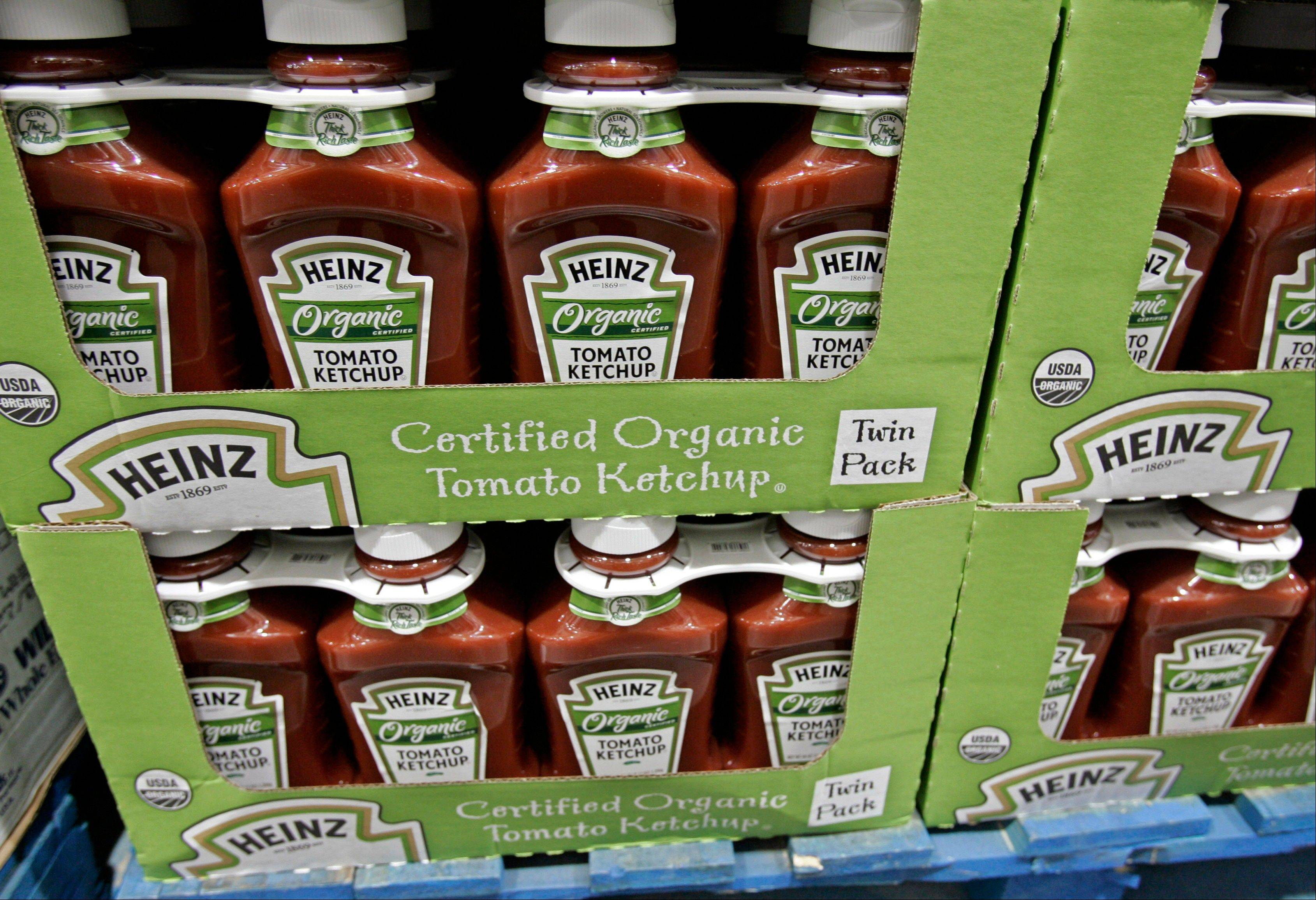 Bottles of Heinz organic tomato ketchup on display inside Costco in Mountain View, Calif. The organic industry is gaining clout on Capitol Hill, prompted by rising consumer demand and its entry into traditional farm states.