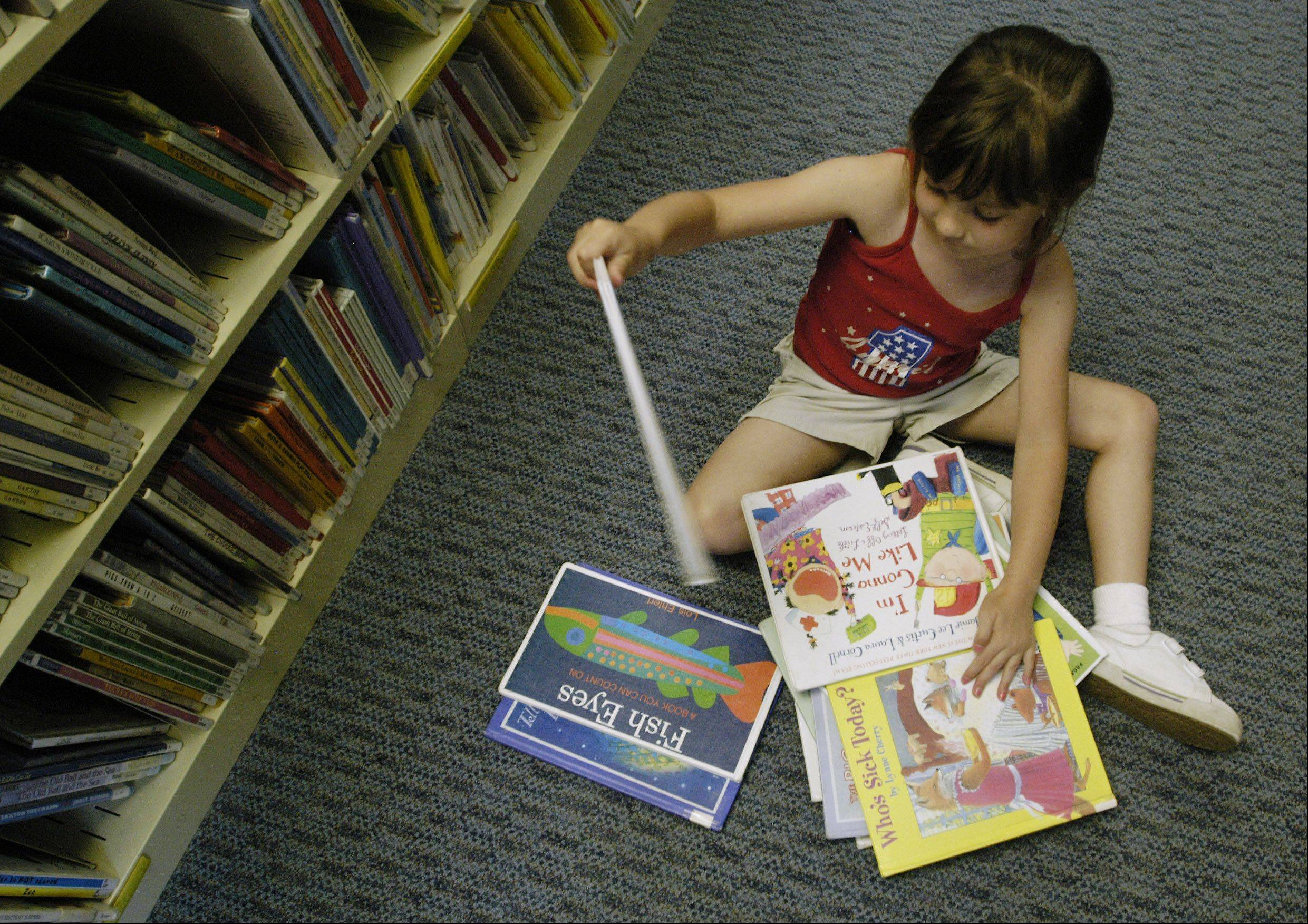 Children will soon begin checking out stacks of books as they begin to participate in summer reading programs throughout the suburbs.