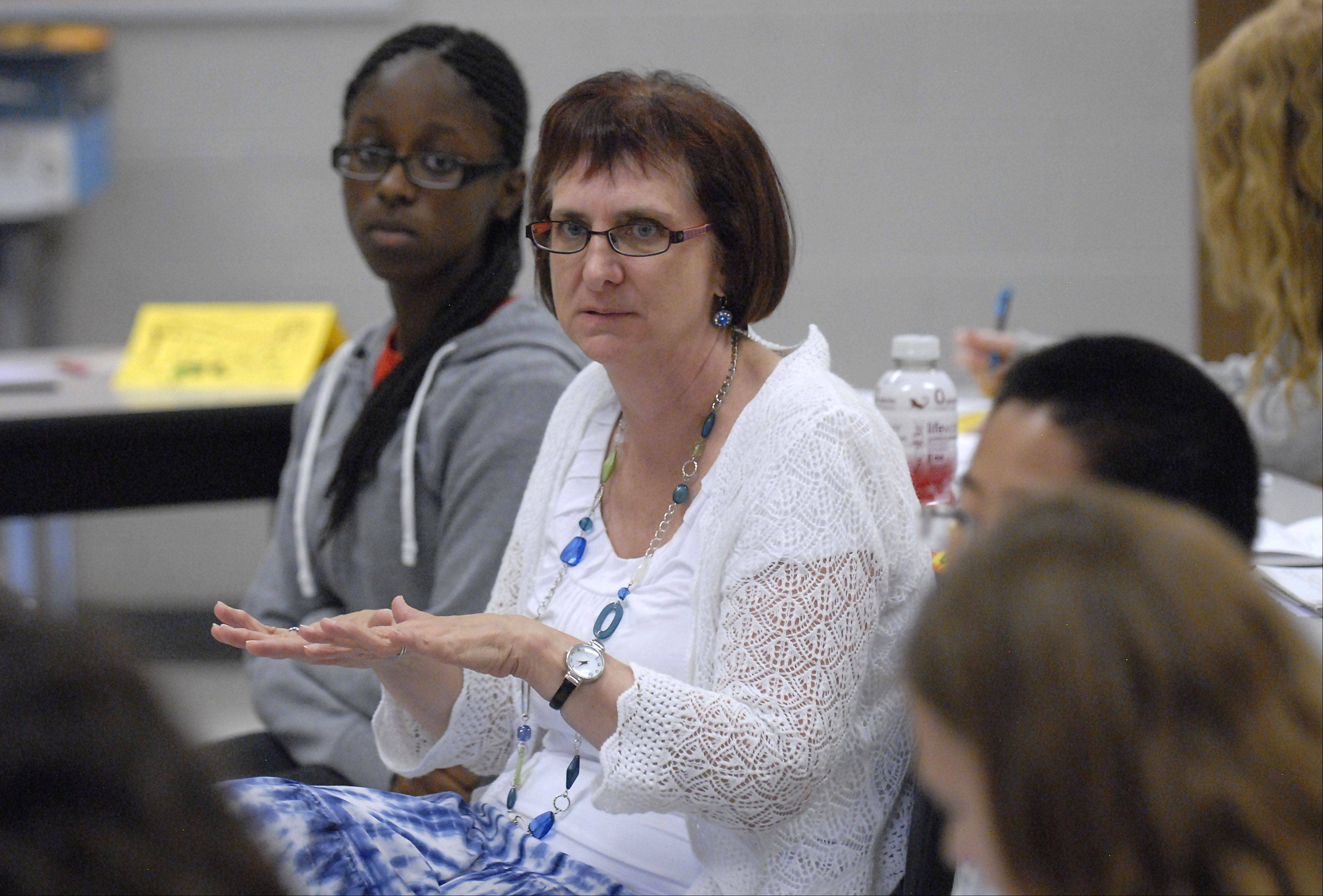 Author Kathi Baron of Oak Park works with students in the College Writing Academy during last year�s Kids College program at Elgin Community College. The class was for students 11 to 15.