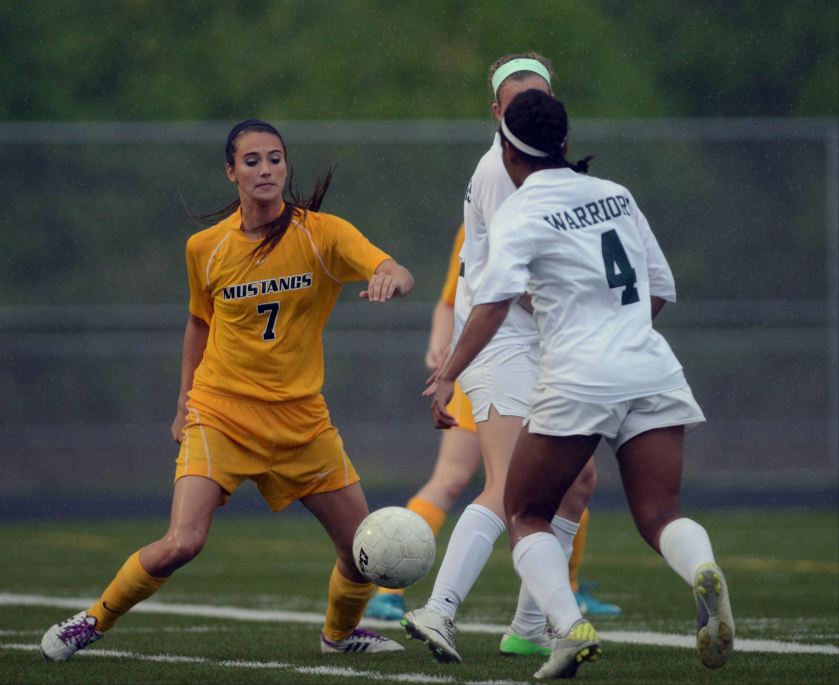 Rachel Stoffregen of Metea Valley,left, and Kristen Dodson of Waubonsie eye the ball during the class 3A girls soccer regional final in Aurora Friday.
