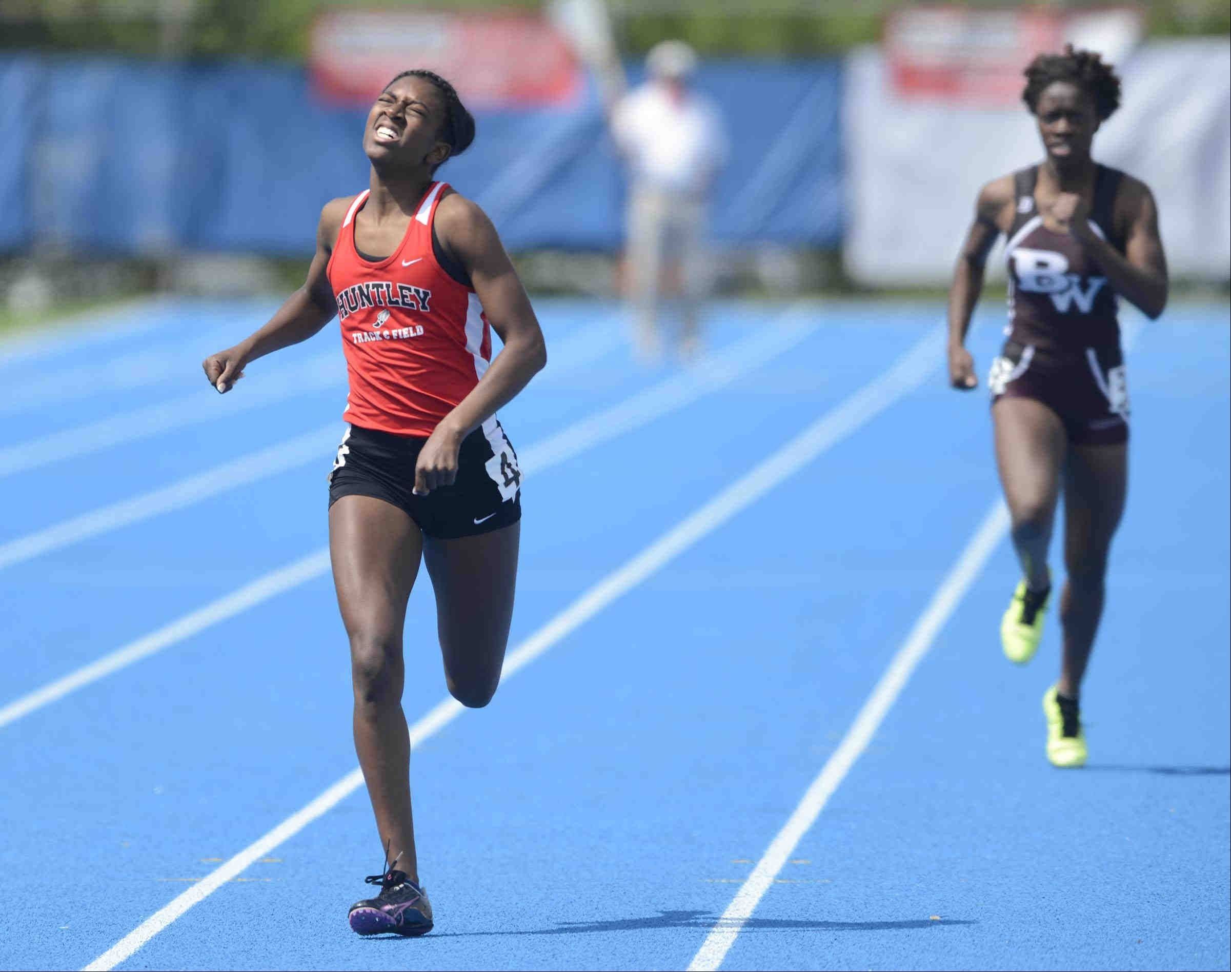 Huntley�s Anthonia Moore strains to finish third in her heat of the 400 meter dash Friday at the Class 3A girls state track and field preliminaries at O�Brien Stadium at Eastern Illinois University in Charleston. Moore qualified for today�s finals.