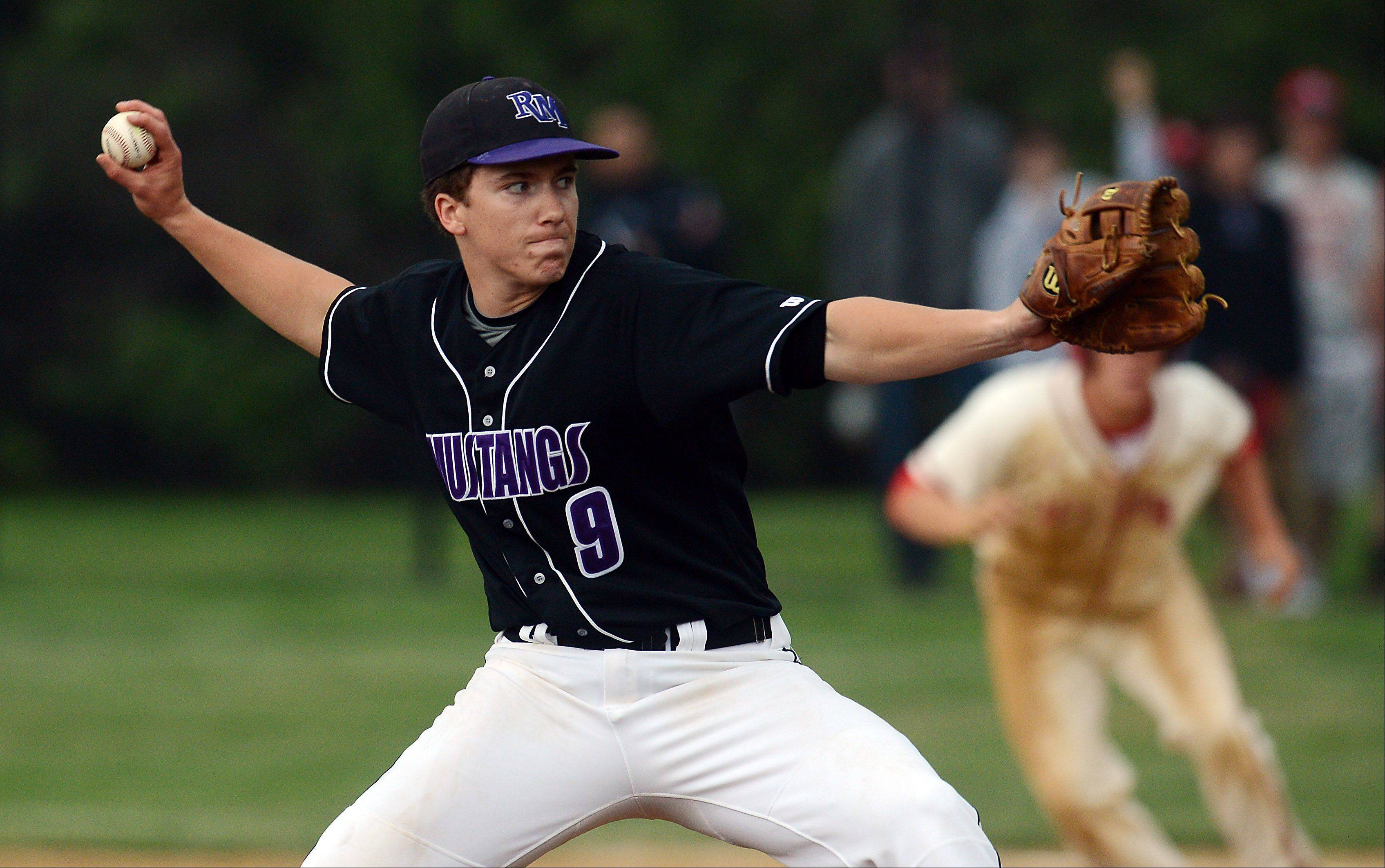 Rolling Meadows pitcher Matt Dennis fires against Barrington in the MSL championship game Friday. Dennis got the win and also hit a 2-run homer in the Mustangs� 11-6 victory.
