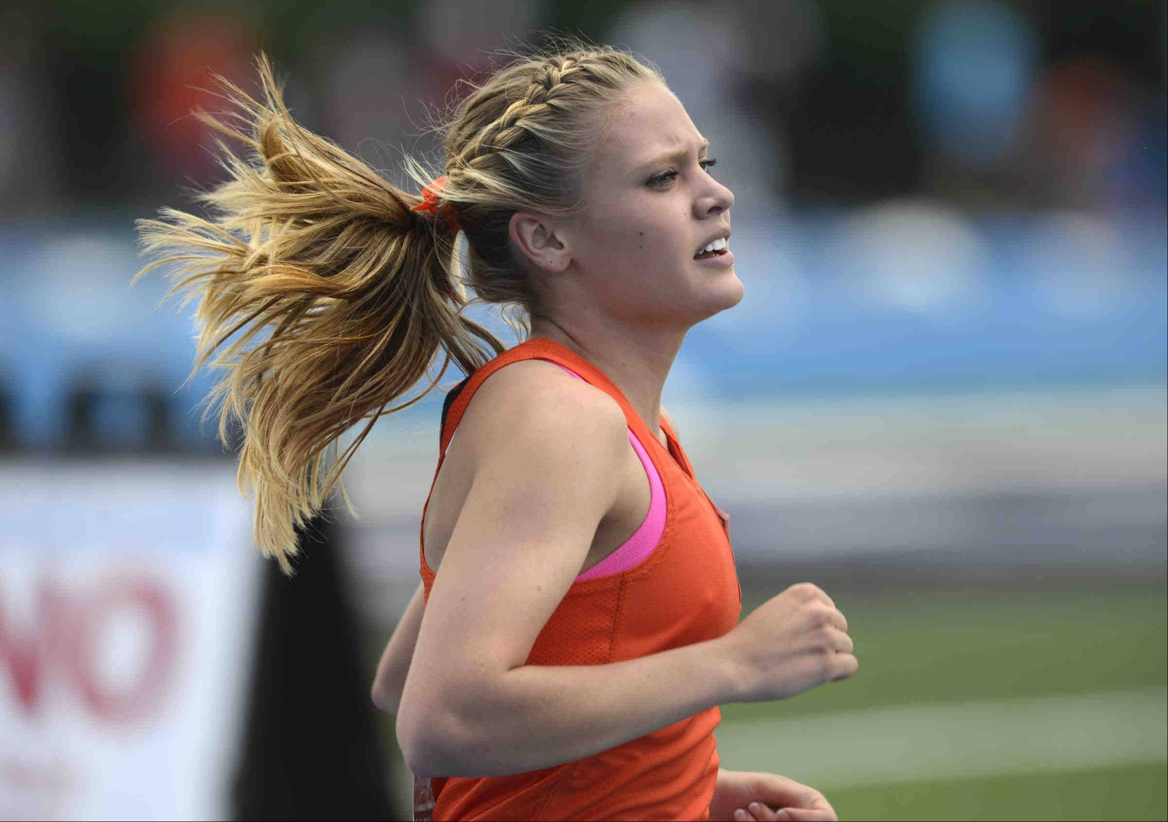 John Starks/jstarks@dailyherald.com Wheaton Warrenville South's Hope Schmelzle leads her heat of the 1,600 meter run Friday at the Class 3A girls state track and field preliminaries at O'Brien Stadium at Eastern Illinois University in Charleston.