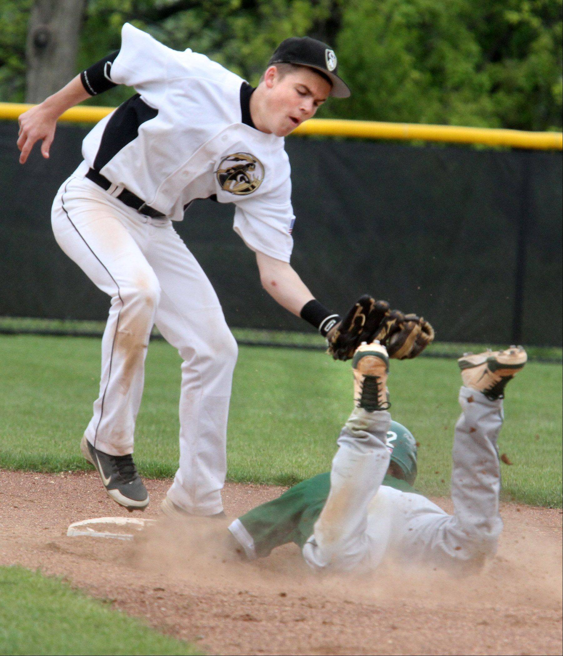 Grayslake North's Nick Carmody tags out Grayslake Central's Ryan Hamrick at second base last weekend. Carmody, the Knights' leadoff hitter, is hitting almost .400 this spring.