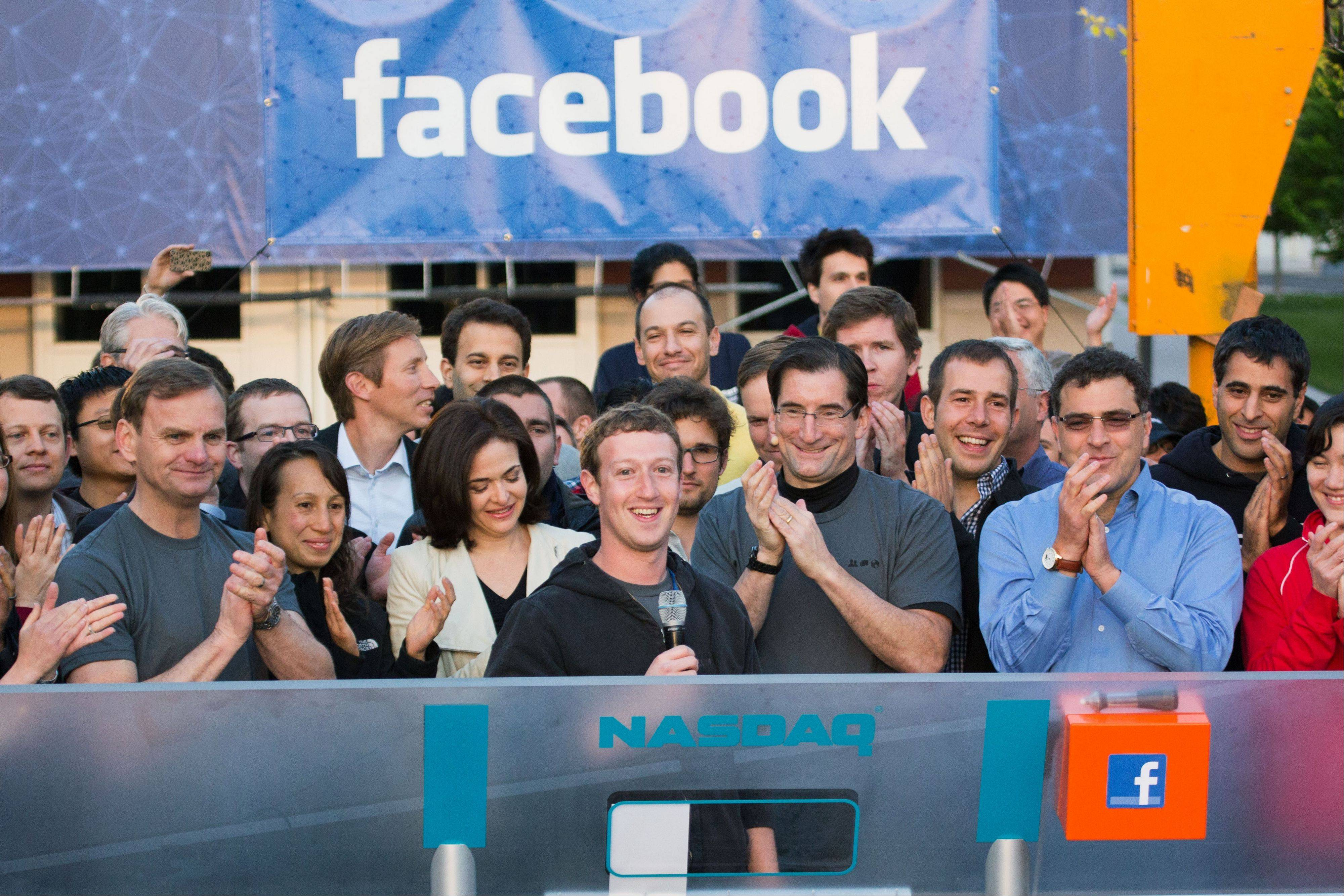Facebook founder, Chairman and CEO Mark Zuckerberg, center, rings the opening bell of the Nasdaq stock market a year ago, from Facebook headquarters in Menlo Park, Calif.