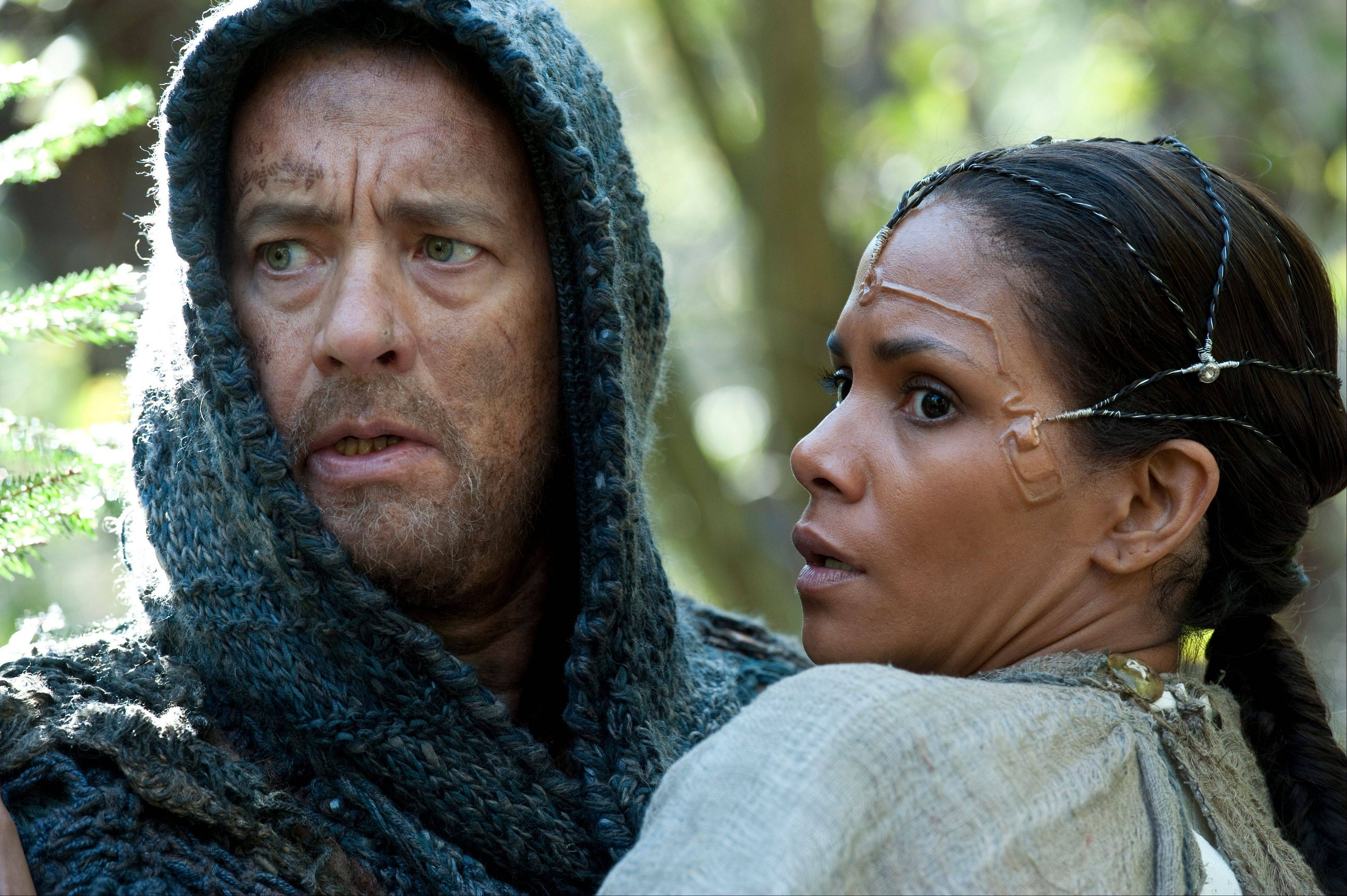 "Zachry (Tom Hanks) accompanies Meronym (Halle Berry) through a dangerous forest in the far distant future in ""Cloud Atlas."""