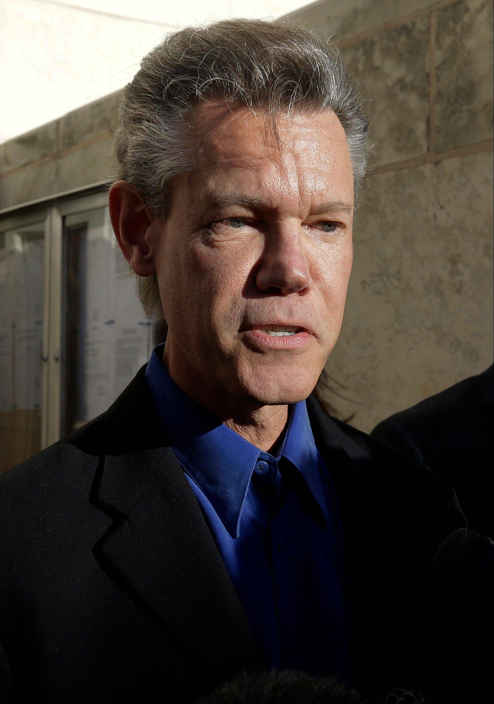 Randy Travis has filed a lawsuit to prevent two state agencies from releasing a patrol car video of his 2012 DWI arrest in North Texas.